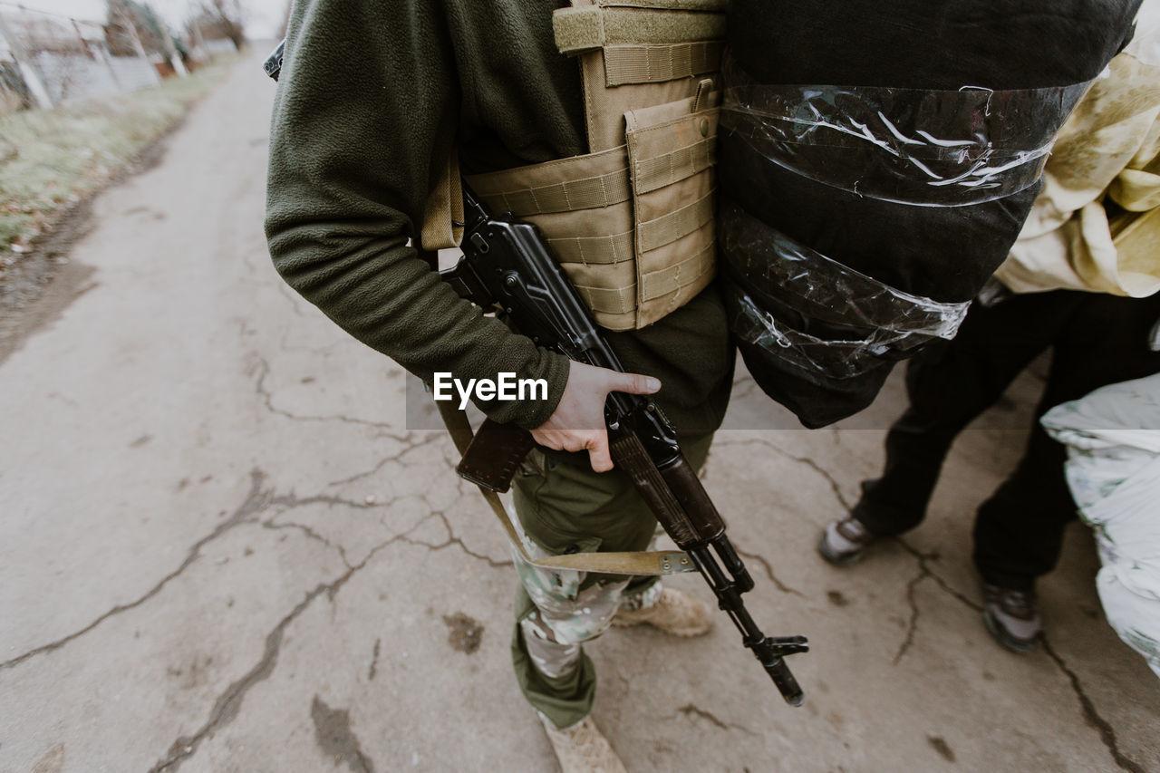 Soldier Standing With Machine Gun