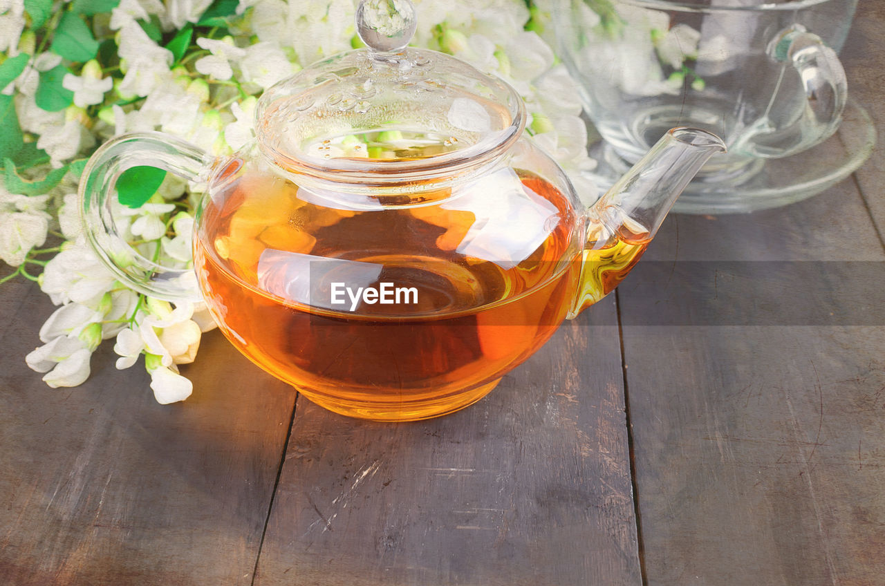 High Angle View Of Herbal Tea In Kettle On Table