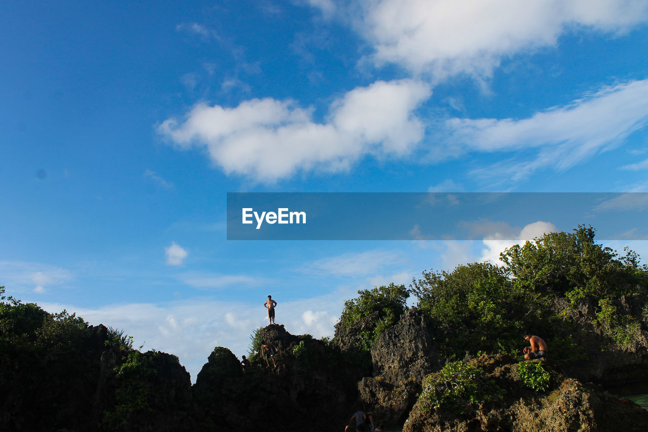 sky, cloud - sky, tree, plant, beauty in nature, nature, scenics - nature, day, mountain, lifestyles, real people, tranquility, leisure activity, low angle view, tranquil scene, rock, people, non-urban scene, outdoors, rock - object