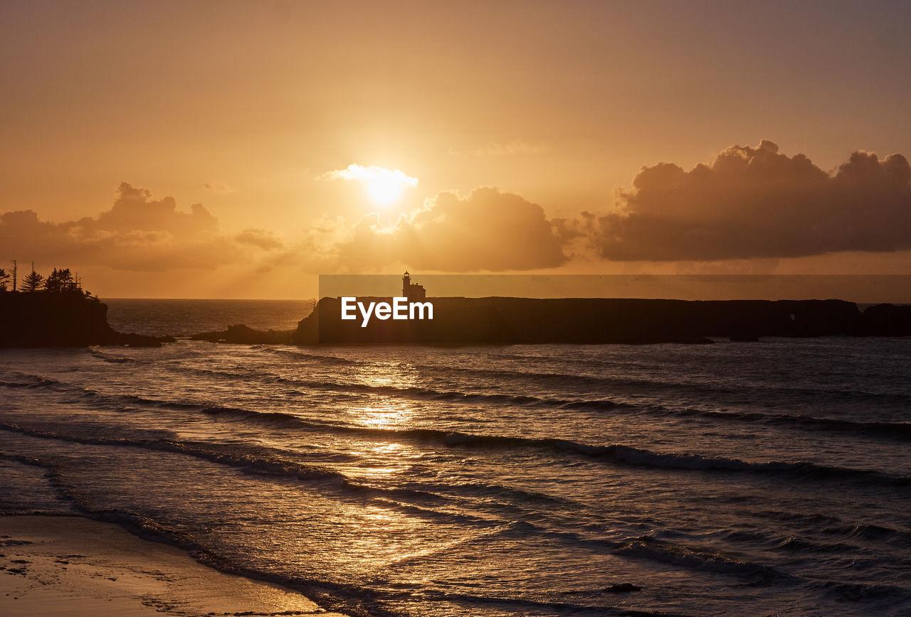 sunset, sky, water, sea, beauty in nature, scenics - nature, orange color, tranquil scene, tranquility, land, beach, sunlight, nature, silhouette, cloud - sky, idyllic, sun, horizon, non-urban scene, outdoors, horizon over water