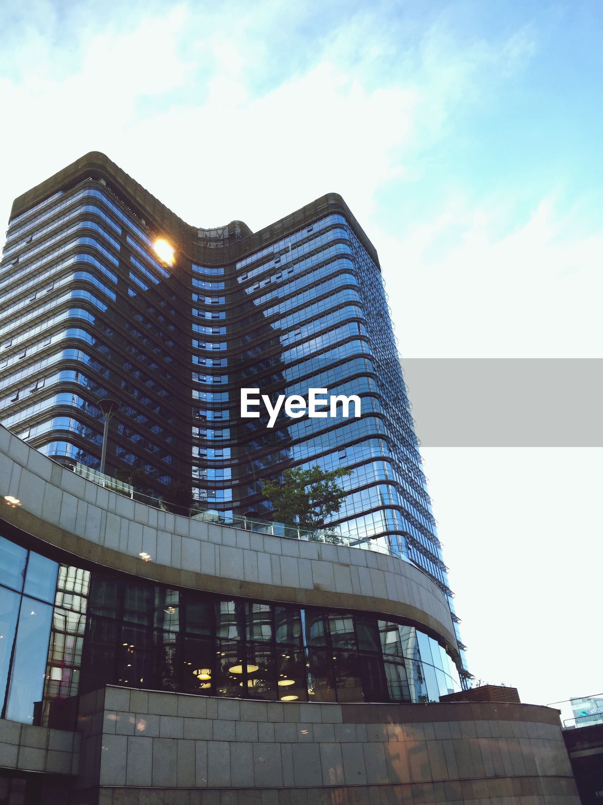 architecture, built structure, building exterior, low angle view, modern, city, office building, sky, skyscraper, tall - high, tower, building, glass - material, reflection, cloud - sky, outdoors, no people, day, cloud, tall