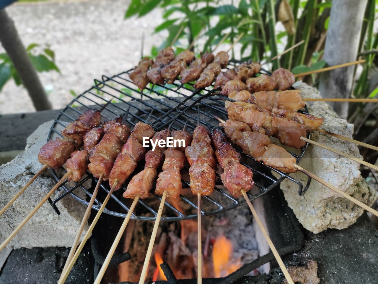 CLOSE-UP OF BARBECUE GRILL WITH MEAT ON BARBEQUE