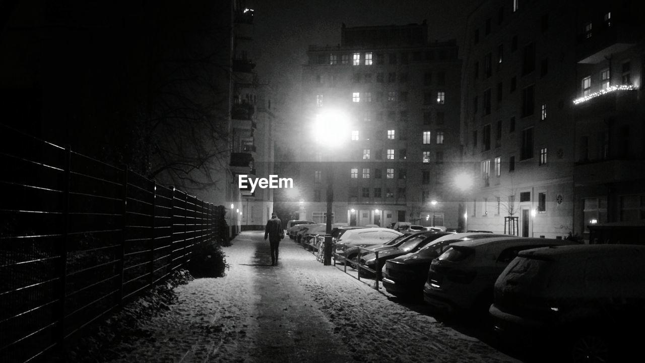night, illuminated, architecture, building exterior, built structure, car, street, street light, transportation, outdoors, city, no people