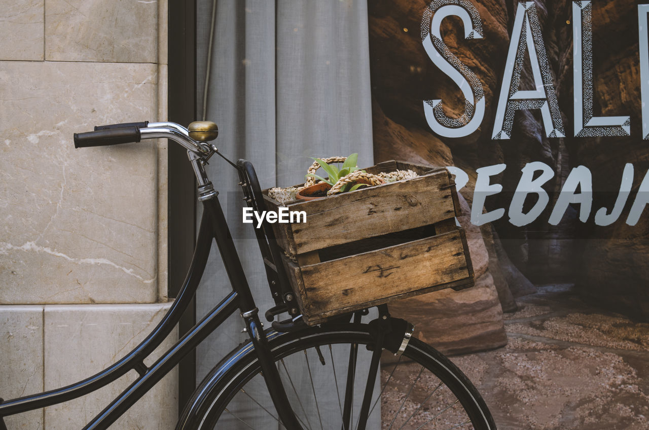 bicycle, no people, text, wall - building feature, day, architecture, basket, container, transportation, outdoors, land vehicle, western script, mode of transportation, communication, nature, metal, built structure, food and drink, food, bicycle basket