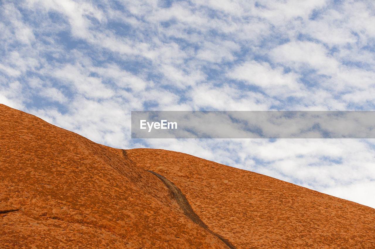 cloud - sky, sky, nature, day, scenics - nature, no people, beauty in nature, tranquility, land, outdoors, environment, brown, low angle view, tranquil scene, desert, landscape, non-urban scene, climate, remote, sand, arid climate