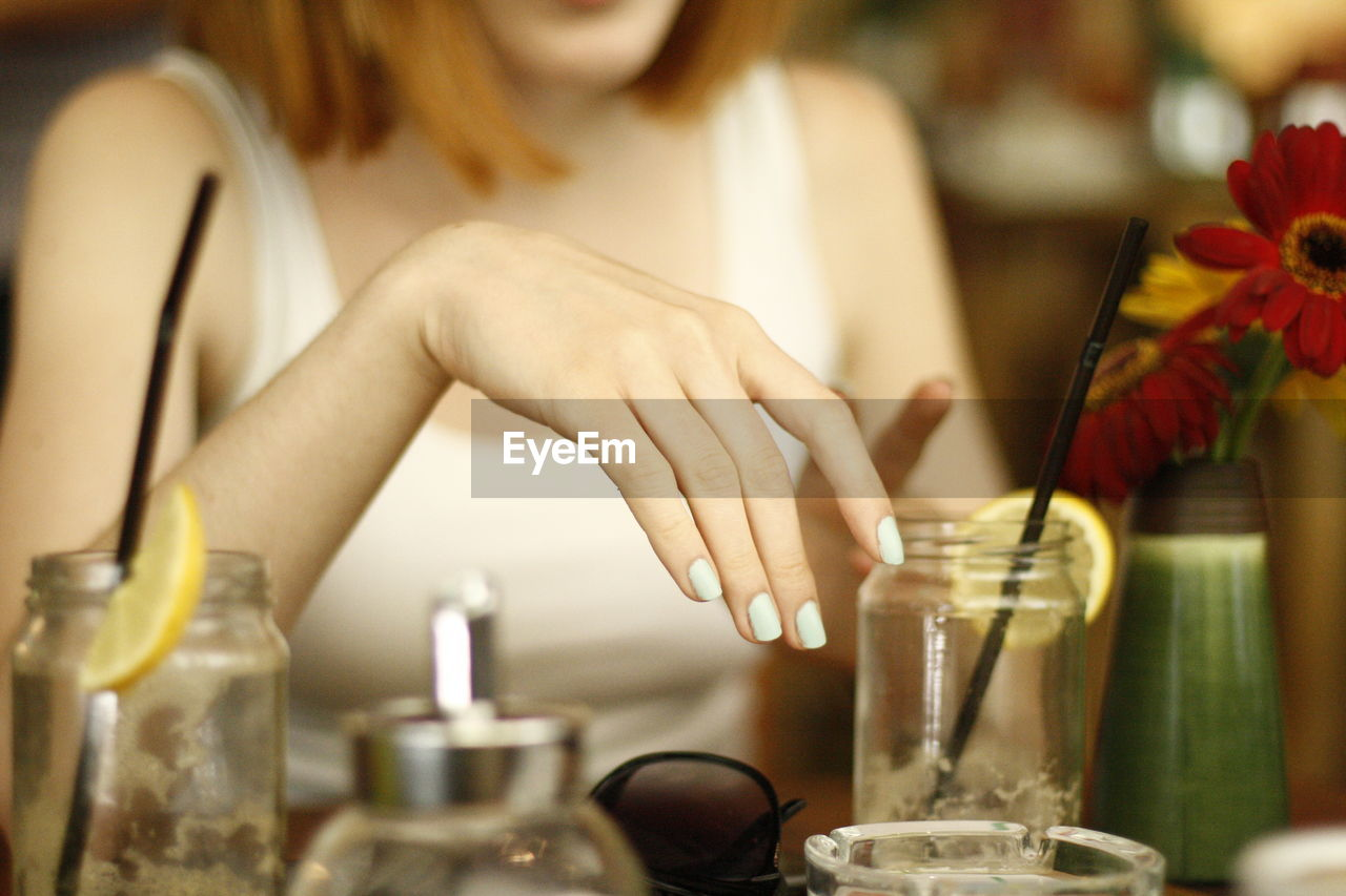 Close-Up Of Woman Sitting In Restaurant