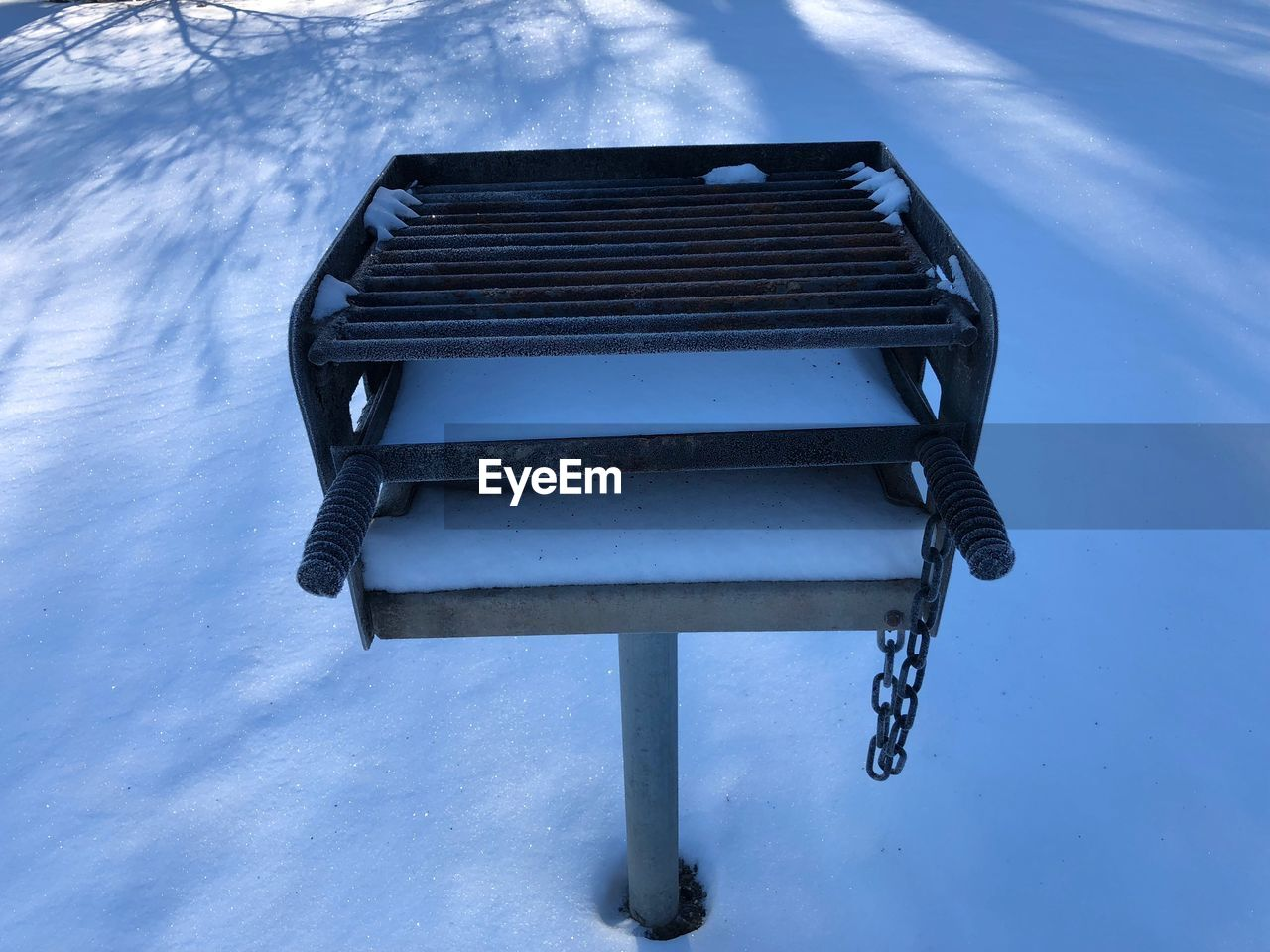 snow, cold temperature, winter, nature, blue, no people, seat, absence, empty, bench, day, outdoors, park bench, beauty in nature, tranquility, high angle view, park, frozen, wood - material