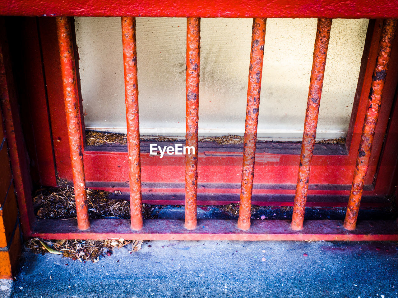 no people, red, day, metal grate, architecture, outdoors, close-up