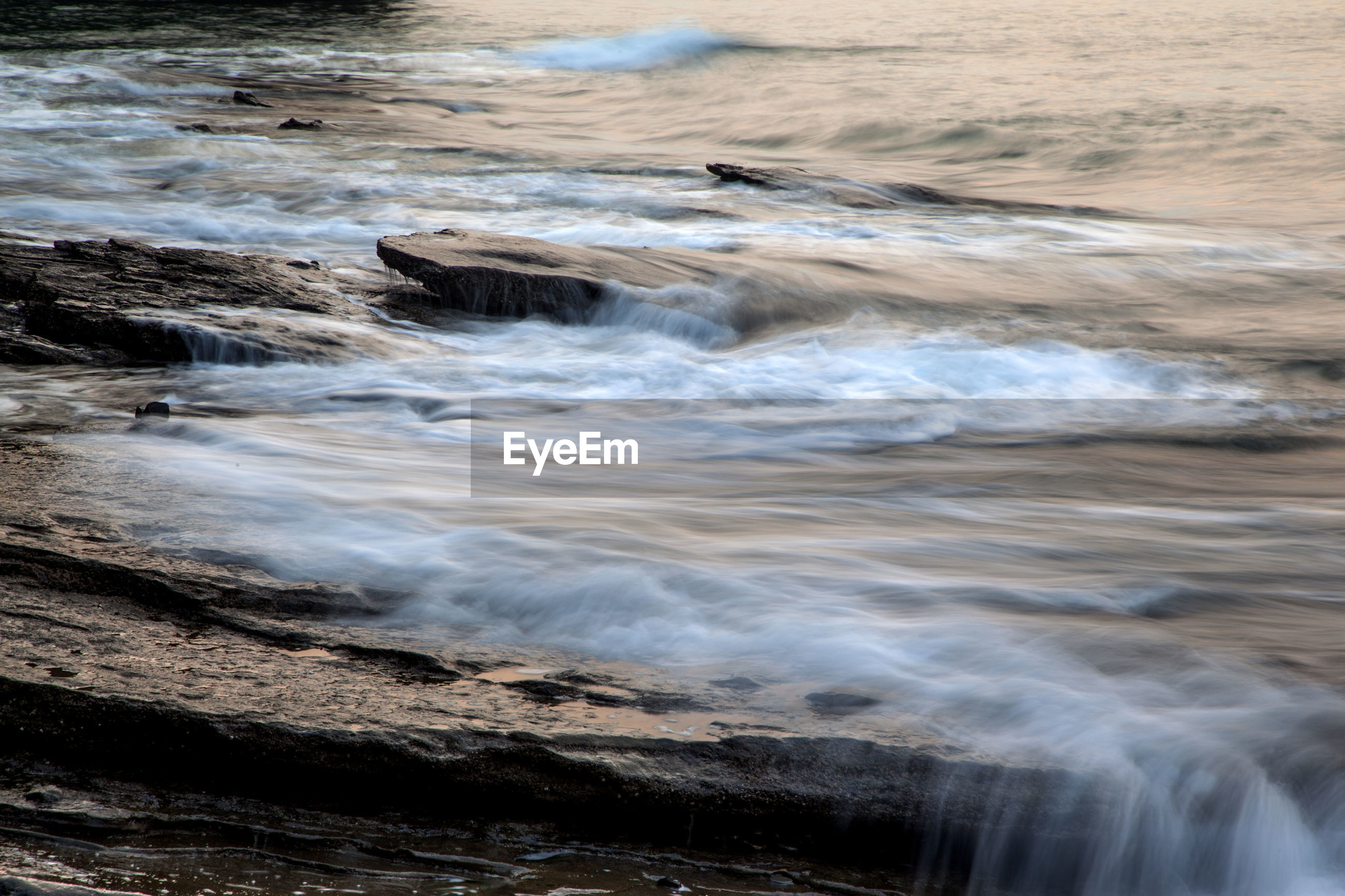 Blurred motion of waves at rocky shore