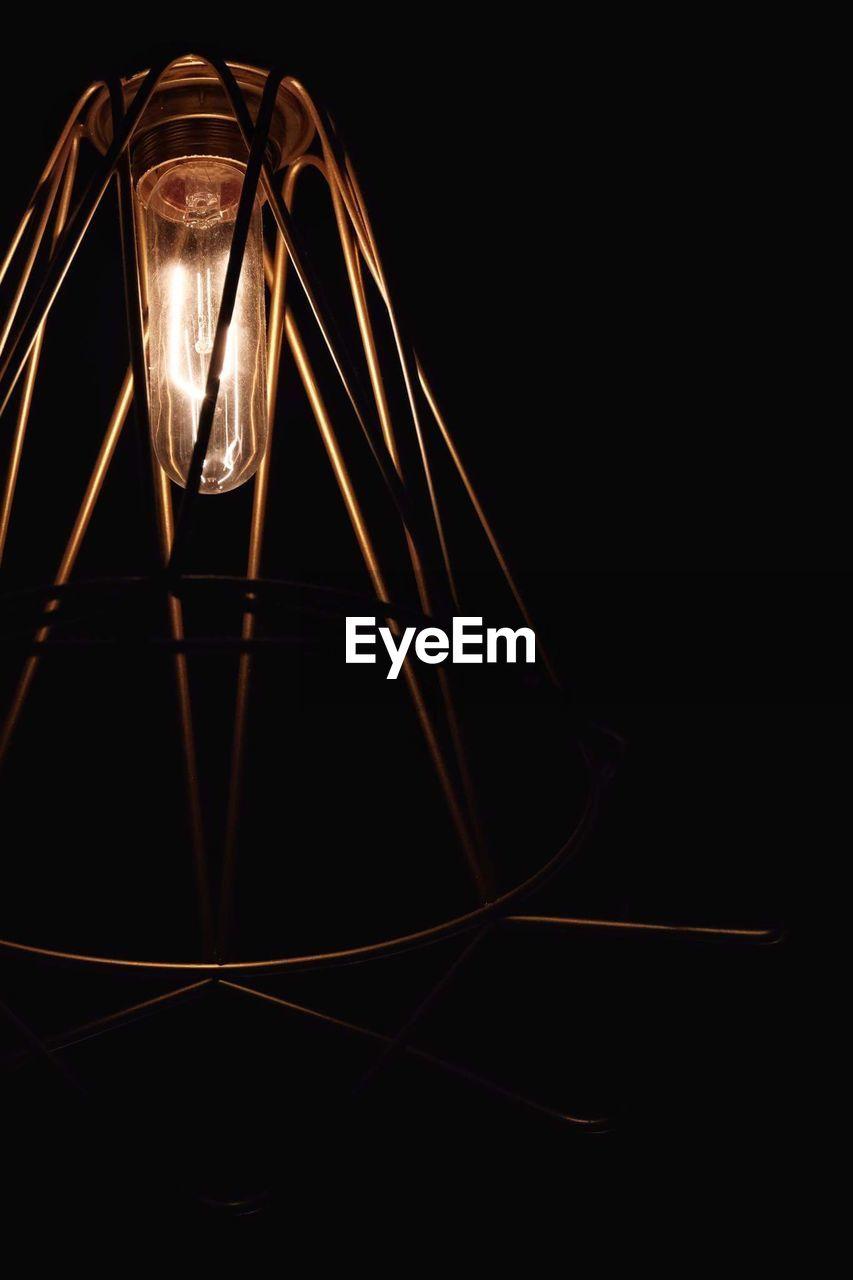 electricity, illuminated, lighting equipment, light bulb, night, dark, black background, no people, studio shot, close-up, filament, indoors, technology