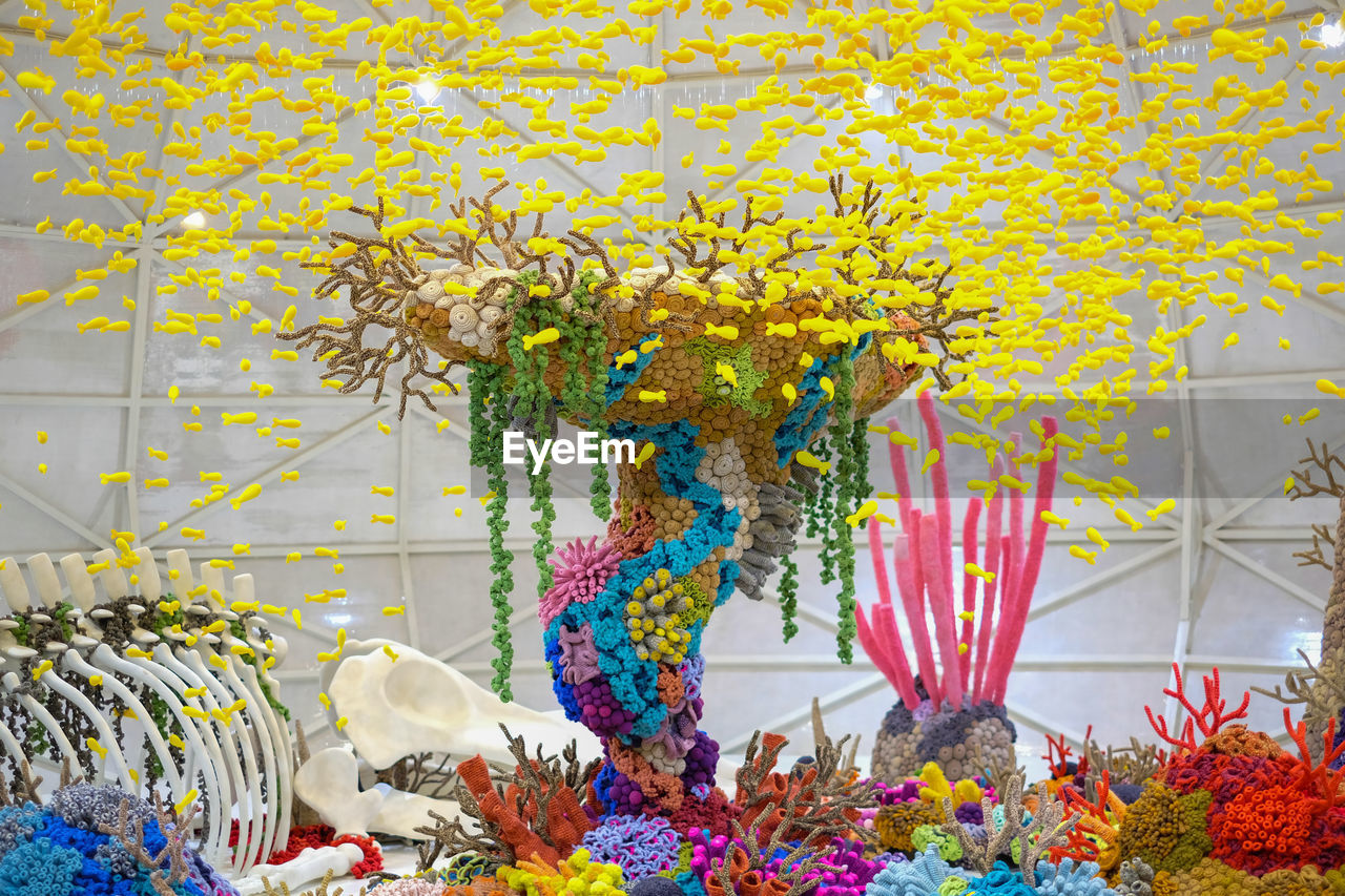 flowering plant, flower, plant, freshness, multi colored, yellow, nature, decoration, no people, growth, vulnerability, fragility, day, celebration, close-up, creativity, hanging, beauty in nature, outdoors, flower head, floral garland, flower arrangement