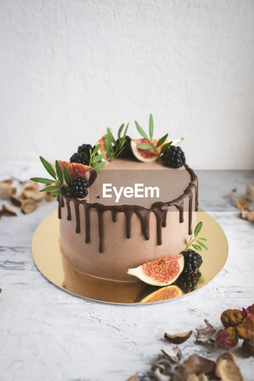 food and drink, food, sweet food, freshness, dessert, still life, sweet, indoors, indulgence, table, baked, cake, temptation, fruit, no people, ready-to-eat, unhealthy eating, close-up, celebration, mint leaf - culinary