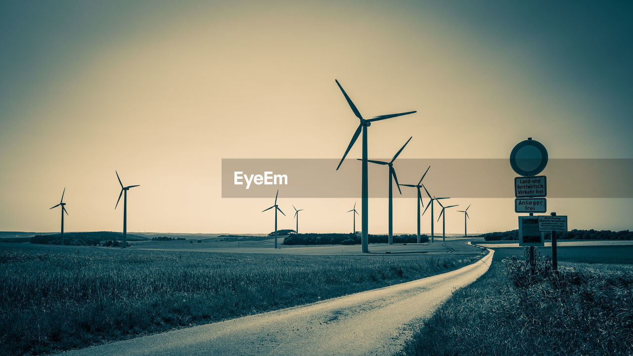 fuel and power generation, environmental conservation, turbine, wind turbine, sky, renewable energy, environment, alternative energy, wind power, technology, transportation, road, nature, no people, field, landscape, the way forward, direction, cold temperature, snow, outdoors, sustainable resources
