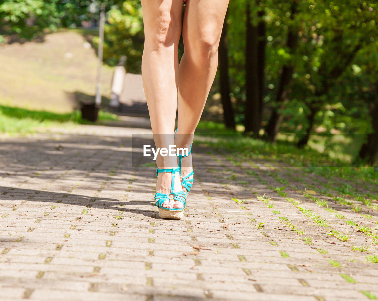 human body part, body part, human leg, low section, lifestyles, women, one person, footpath, running, adult, limb, shoe, day, human limb, street, healthy lifestyle, city, sport, motion, outdoors, human foot, paving stone, effort