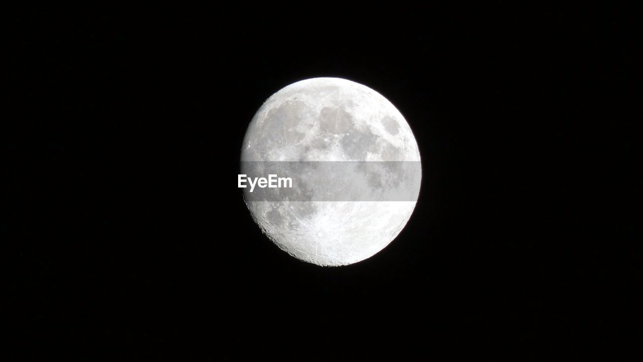 astronomy, moon, space, night, sky, planetary moon, moon surface, beauty in nature, copy space, scenics - nature, geometric shape, circle, full moon, low angle view, no people, tranquility, nature, shape, majestic, space exploration, outdoors, dark, moonlight, space and astronomy