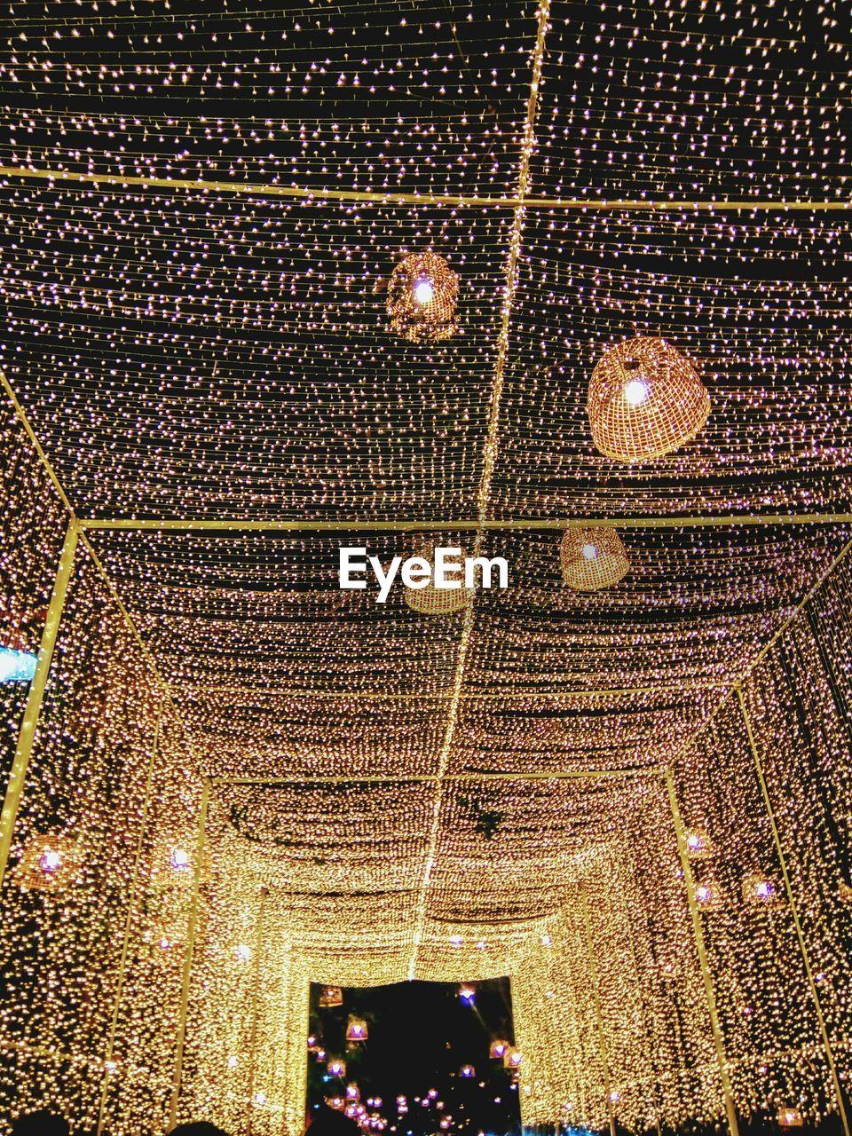 illuminated, night, indoors, lighting equipment, celebration, low angle view, nightlife, no people