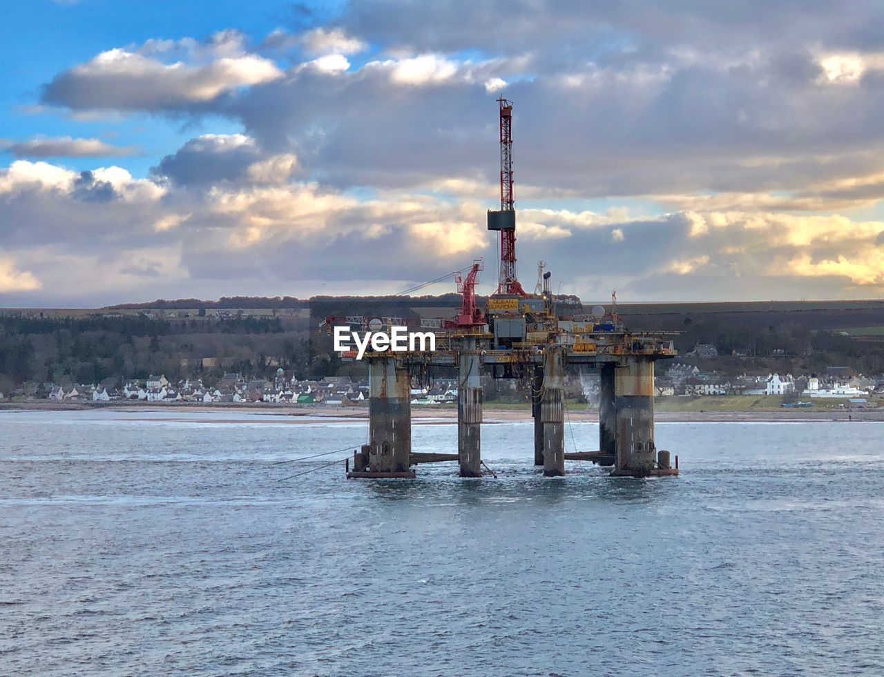water, cloud - sky, waterfront, built structure, sea, architecture, sky, industry, oil industry, nature, fuel and power generation, offshore platform, drilling rig, no people, building exterior, sunset, outdoors, day, scenics - nature