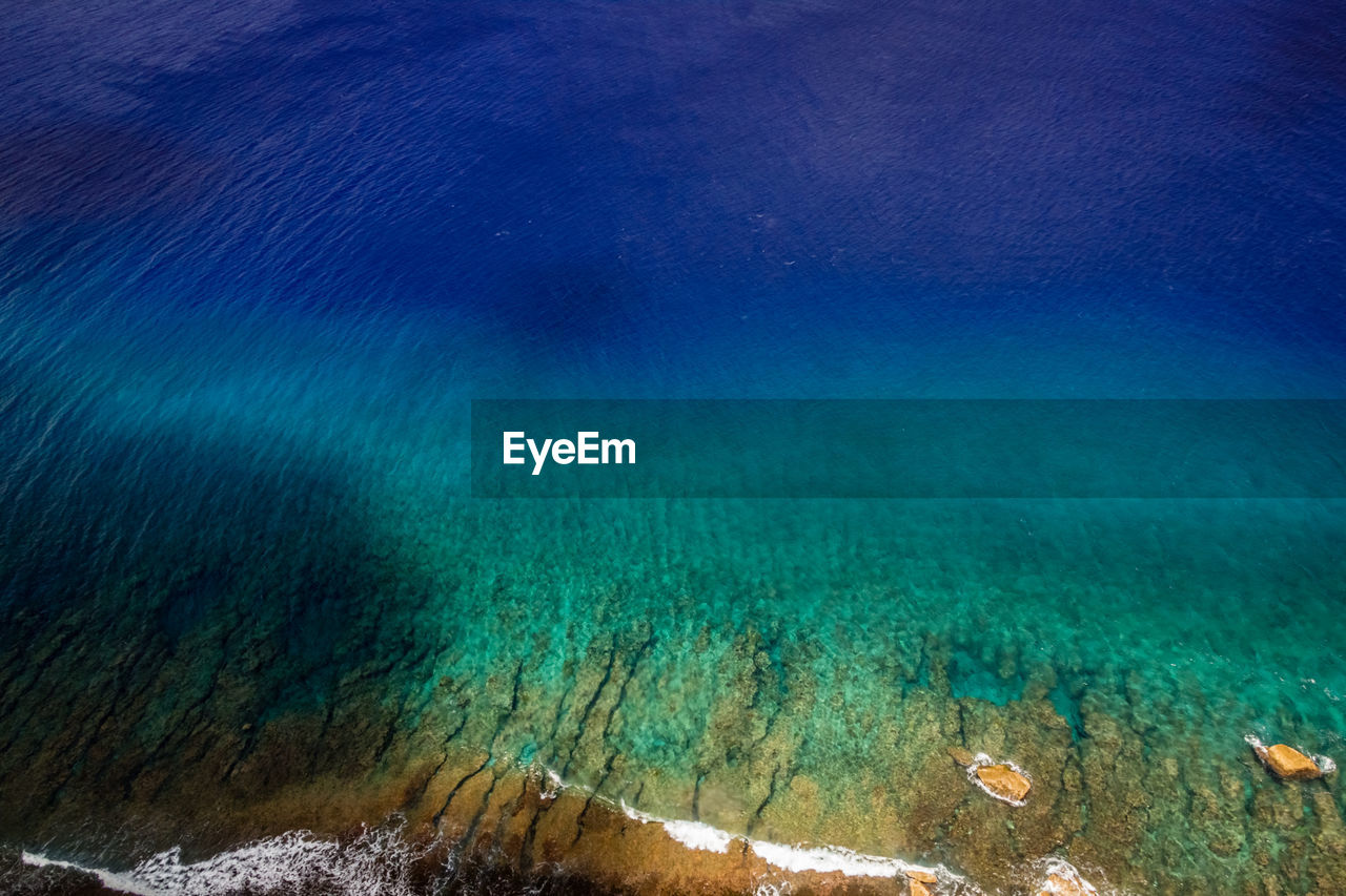 beauty in nature, water, sea, nature, scenics - nature, underwater, no people, undersea, blue, day, outdoors, tranquility, land, turquoise colored, tranquil scene, waterfront, idyllic, sea life, beach, marine