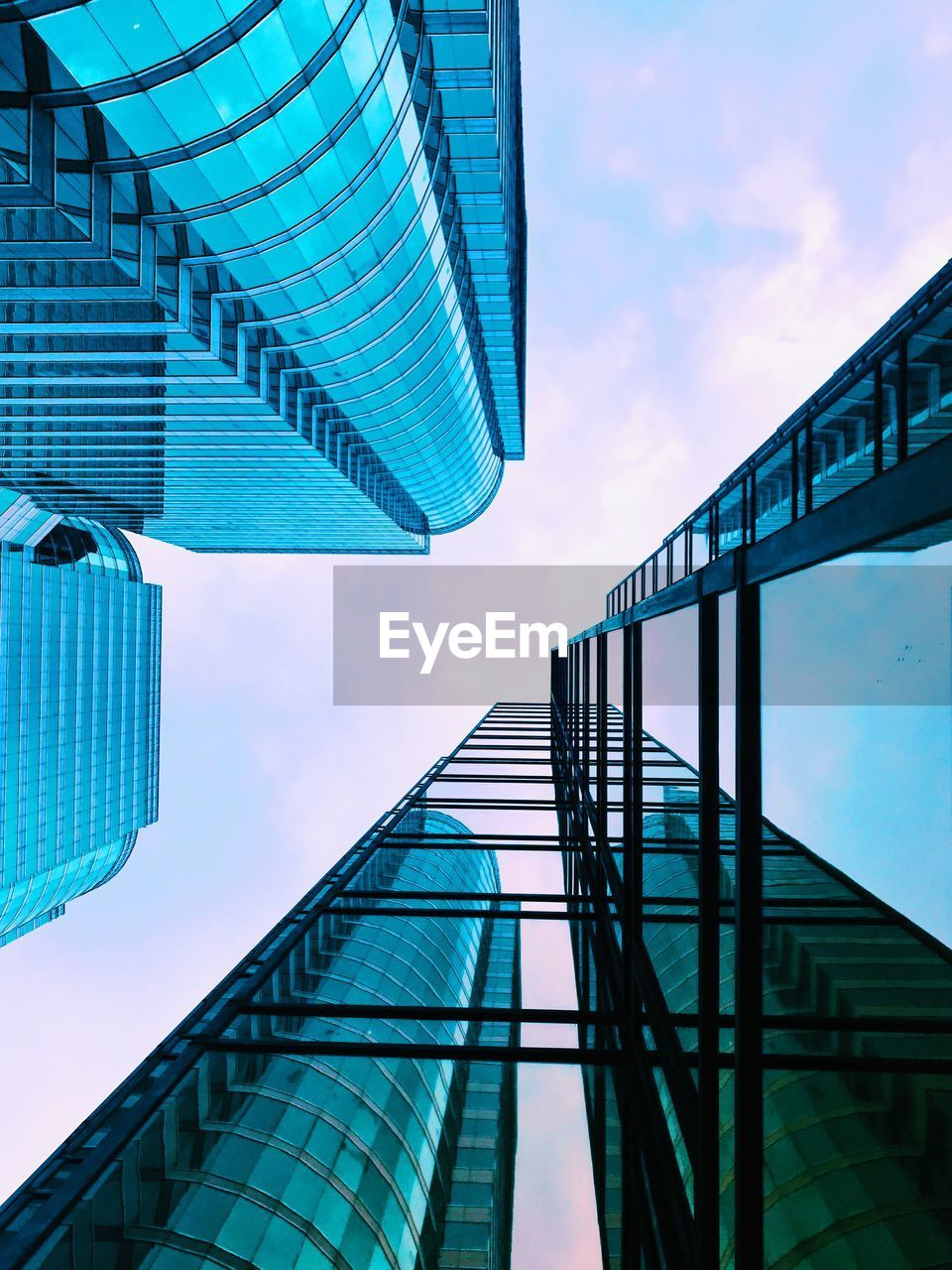 architecture, built structure, building exterior, sky, city, modern, building, low angle view, office building exterior, cloud - sky, office, no people, glass - material, nature, tall - high, day, skyscraper, reflection, outdoors, tower, directly below, financial district