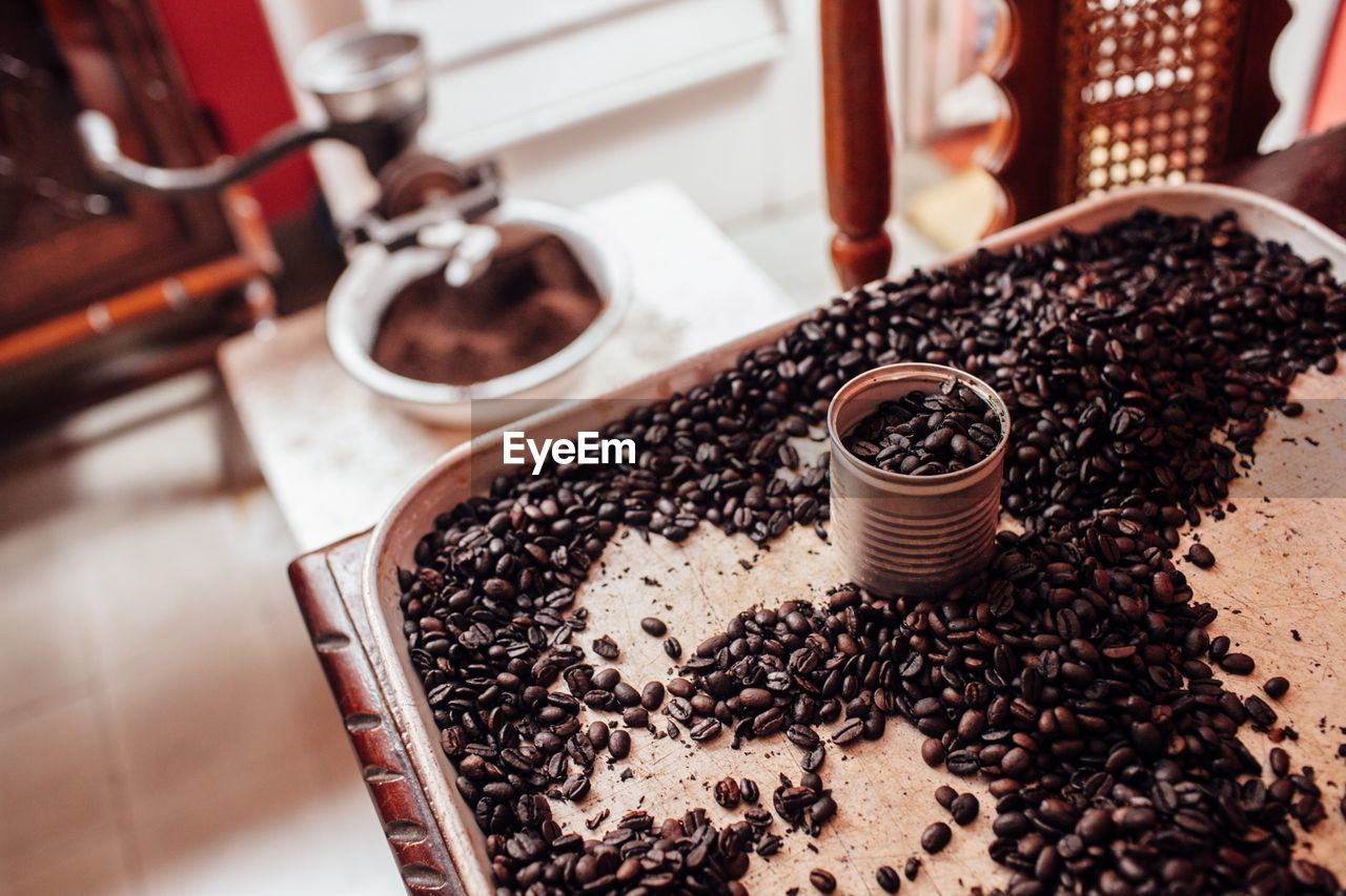 food and drink, indoors, high angle view, coffee - drink, food, coffee, roasted coffee bean, freshness, focus on foreground, brown, drink, still life, no people, table, refreshment, ground coffee, close-up, container, coffee bean, preparation, caffeine