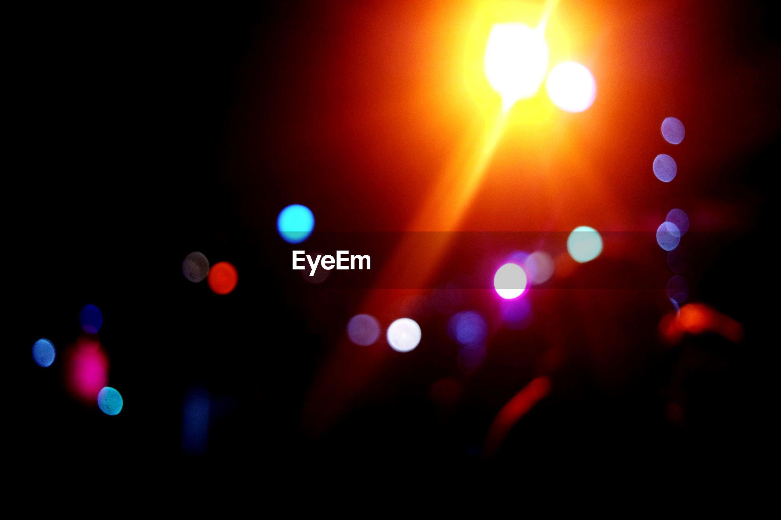 Close-up of illuminated blurred lights at night