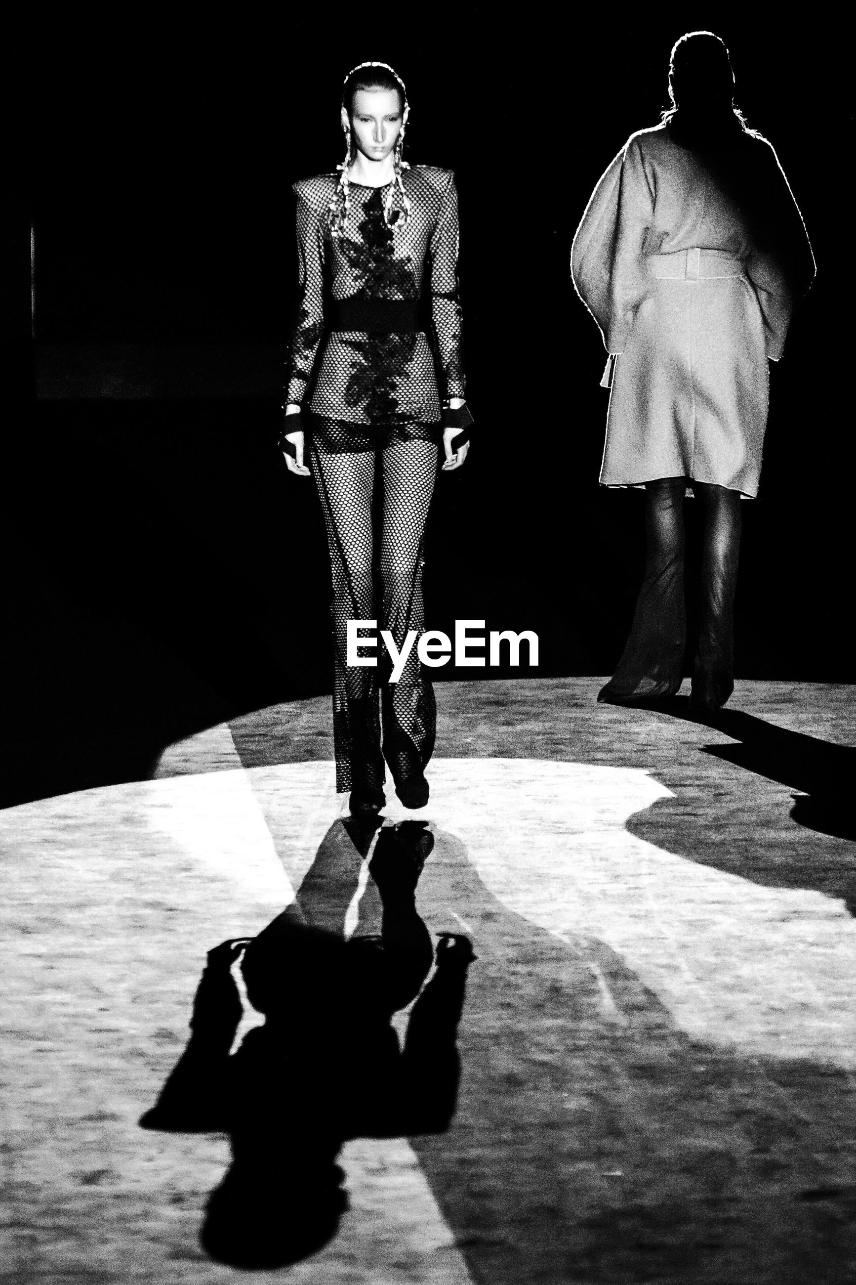 black, black and white, monochrome, monochrome photography, full length, white, adult, footwear, shadow, fashion, men, darkness, spring, performance art, standing, women, young adult, clothing, two people, person, indoors, portrait