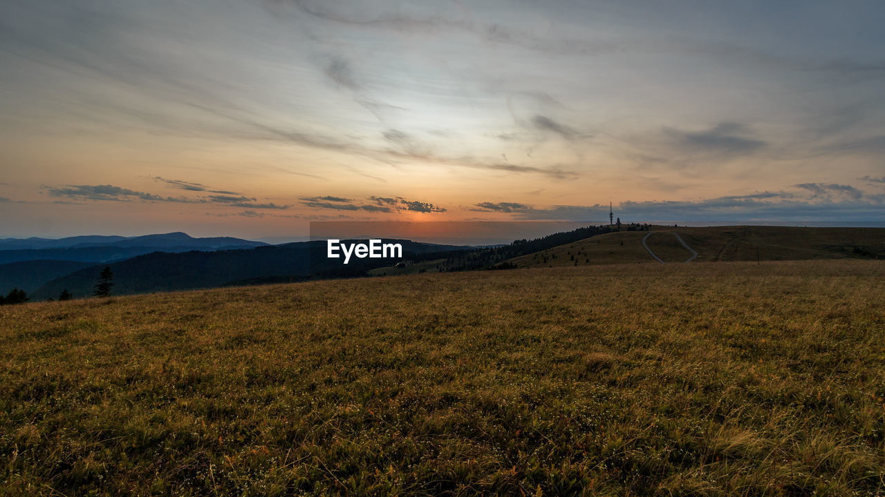 sunset, nature, sky, beauty in nature, landscape, cloud - sky, scenics, no people, grass, tranquil scene, tranquility, outdoors, mountain, day