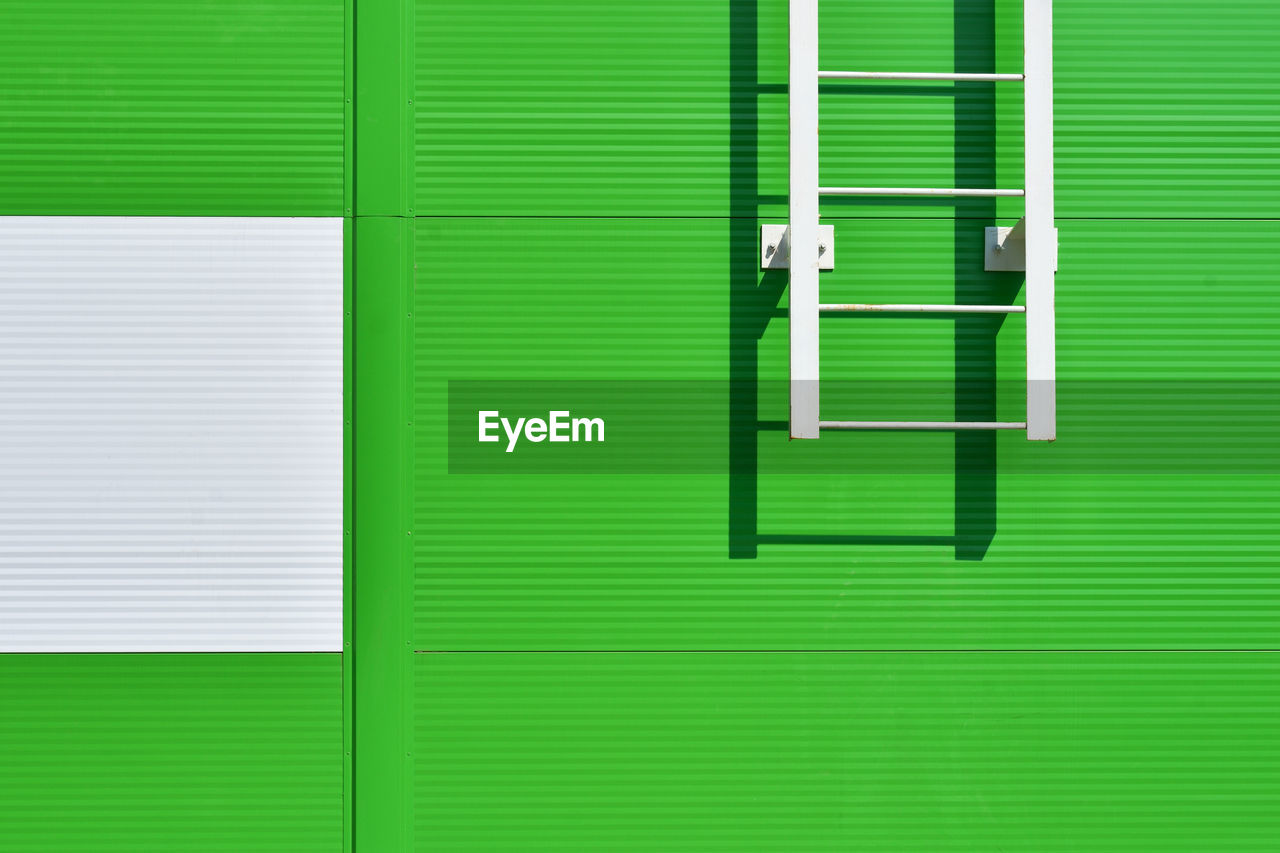 Closed Green Shutter And Ladder