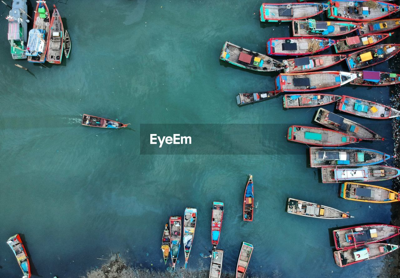High Angle View Of Boats Moored In Sea At Harbor