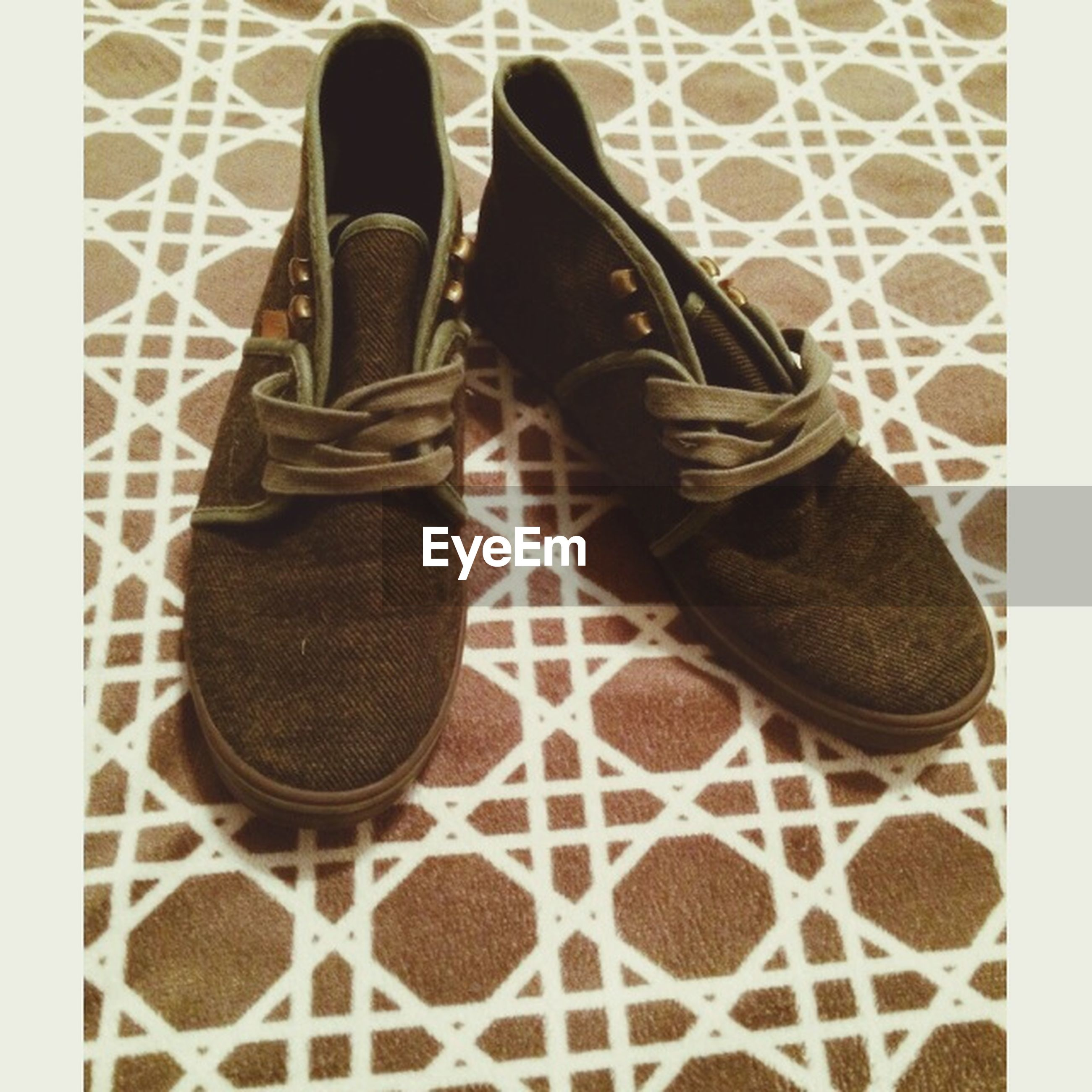 shoe, low section, person, footwear, indoors, high angle view, standing, fashion, human foot, pair, personal perspective, canvas shoe, jeans, men, lifestyles, close-up, shoelace