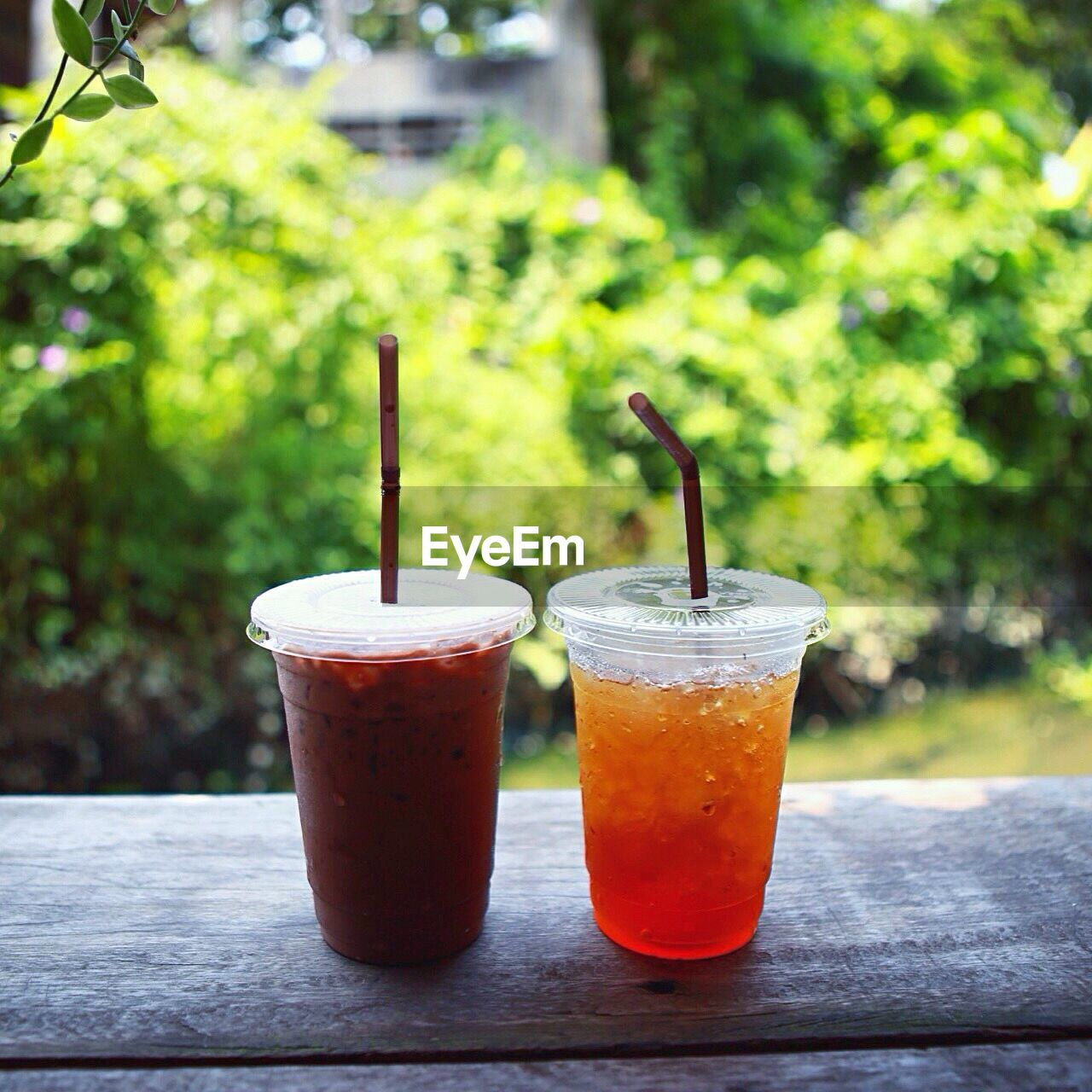 drink, drinking straw, drinking glass, refreshment, table, focus on foreground, food and drink, no people, day, close-up, freshness, outdoors, healthy eating
