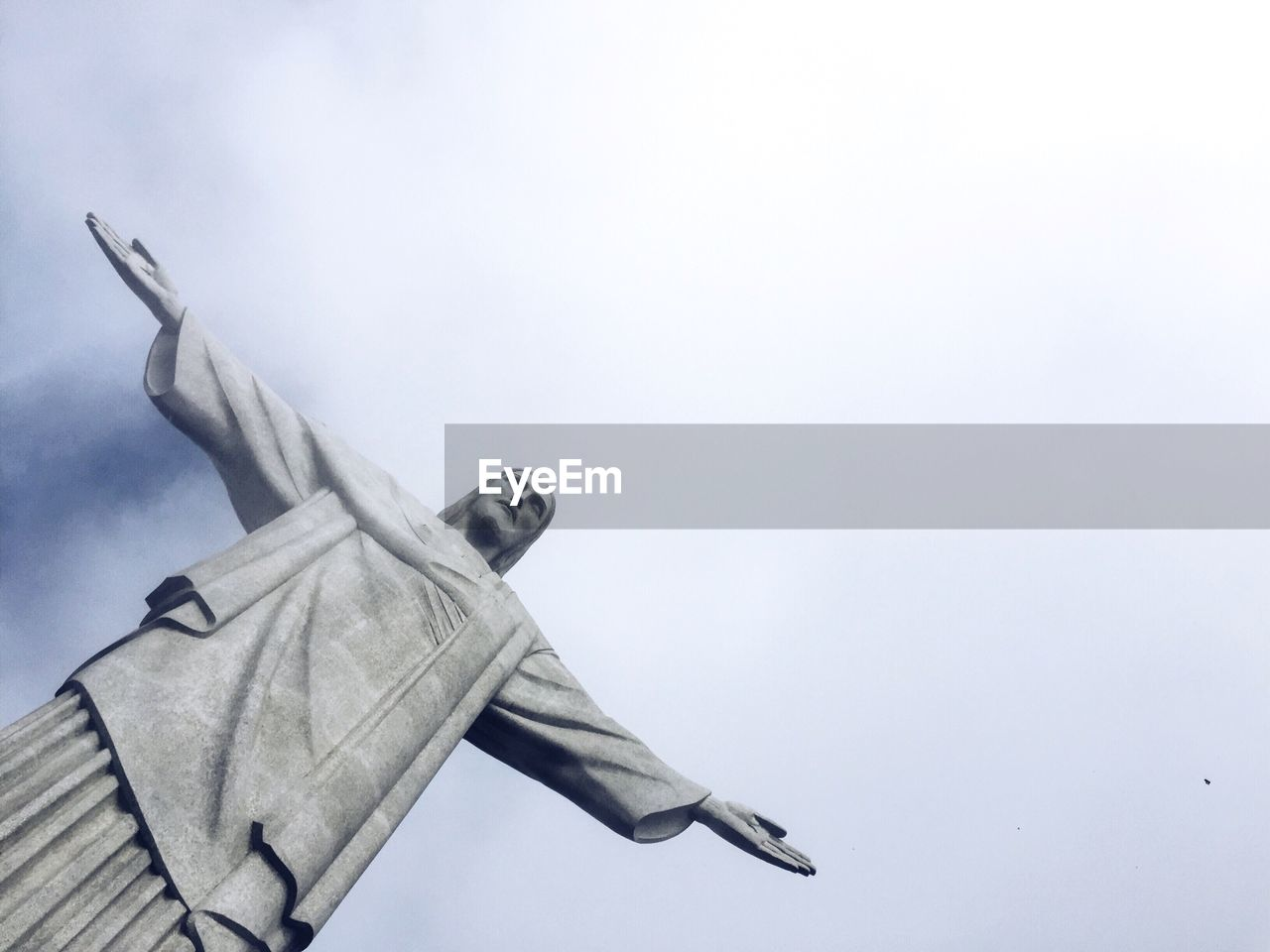 Low angle view of jesus christ statue against sky