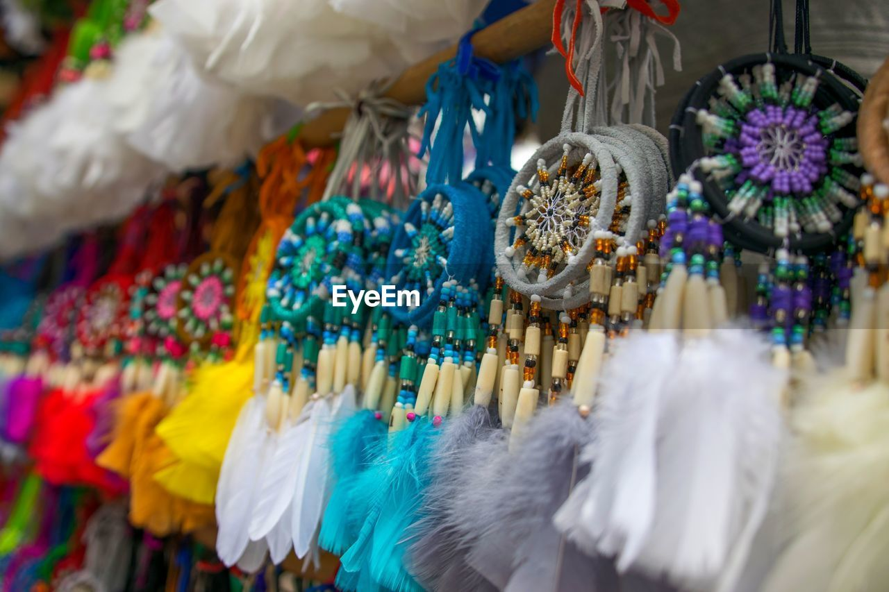 Close-Up Of Colorful Dreamcatchers For Sale In Market