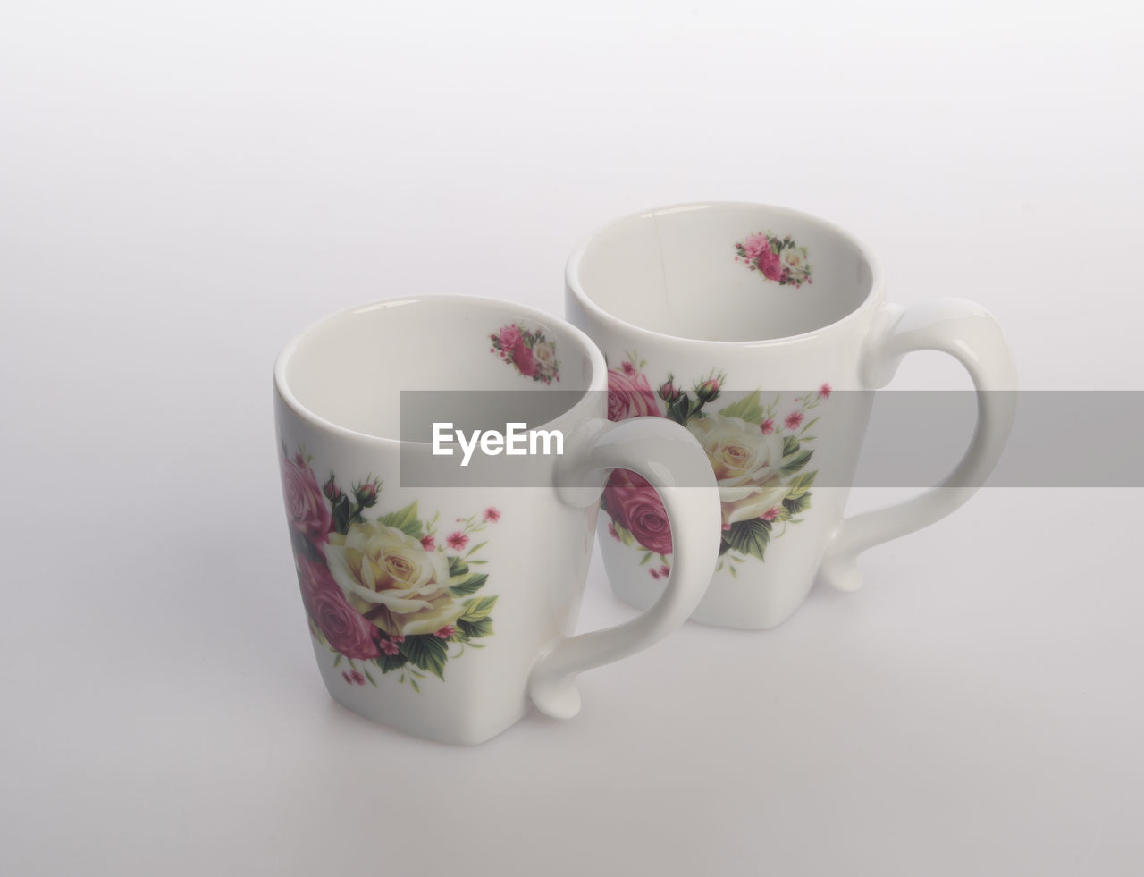 white background, studio shot, cup, indoors, drink, ceramics, no people, still life, refreshment, white color, mug, food and drink, close-up, cut out, copy space, pattern, pink color, flower, porcelain, floral pattern, tea cup, crockery