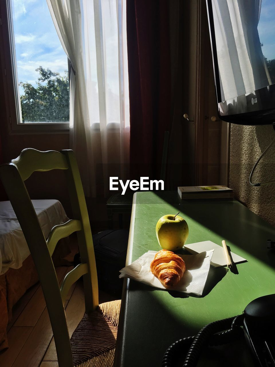 seat, chair, window, table, indoors, curtain, home interior, absence, furniture, day, no people, glass - material, transparent, empty, food and drink, sunlight, sofa, nature, pillow, food, coffee table