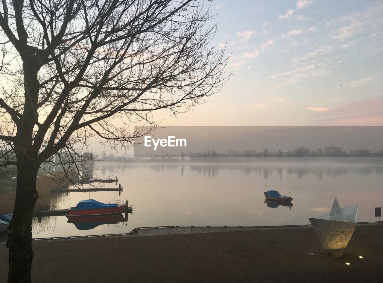 NAUTICAL VESSEL ON LAKE AGAINST SKY