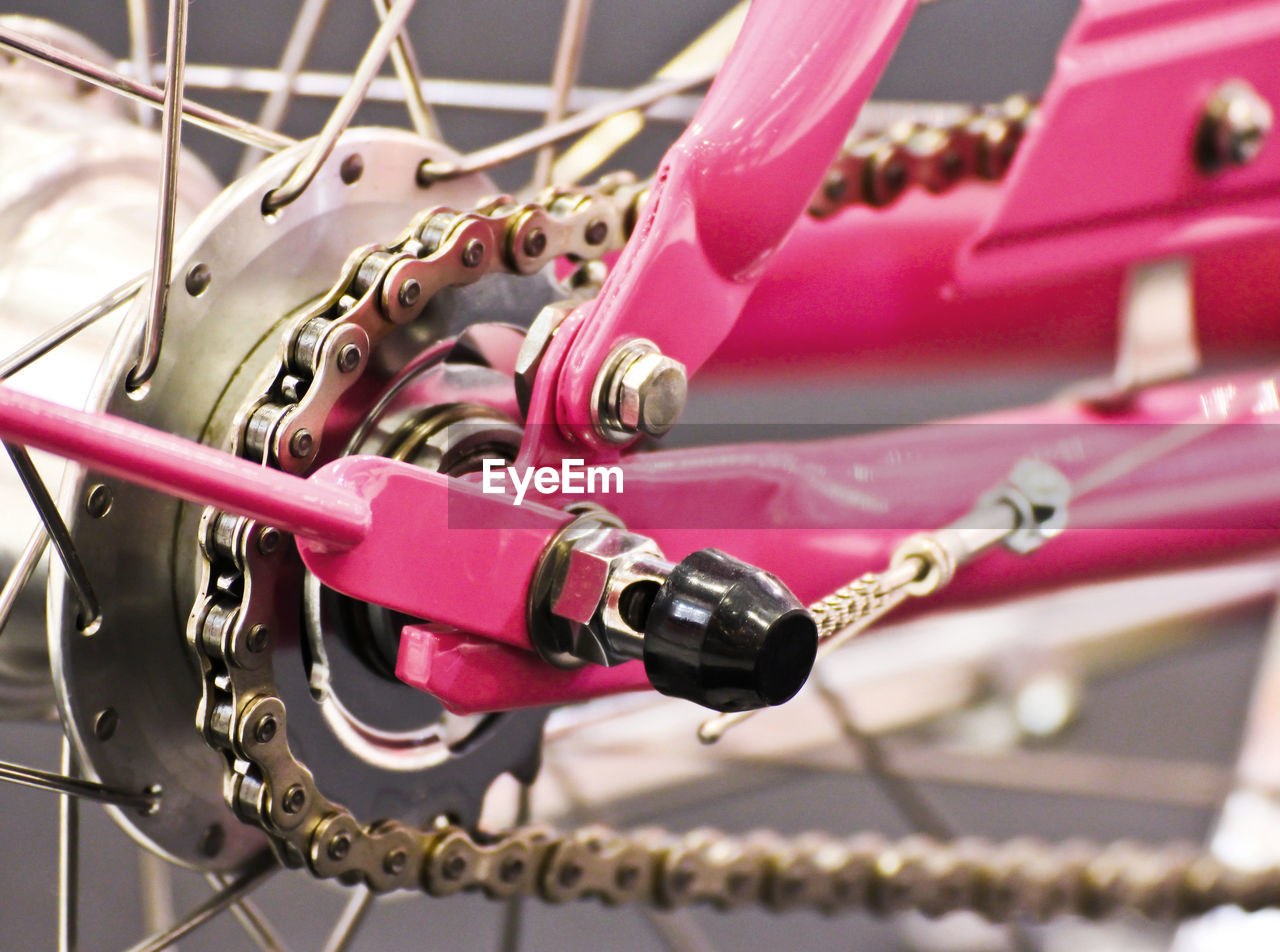 CLOSE-UP OF BICYCLE PARKED ON CHAIN SWING