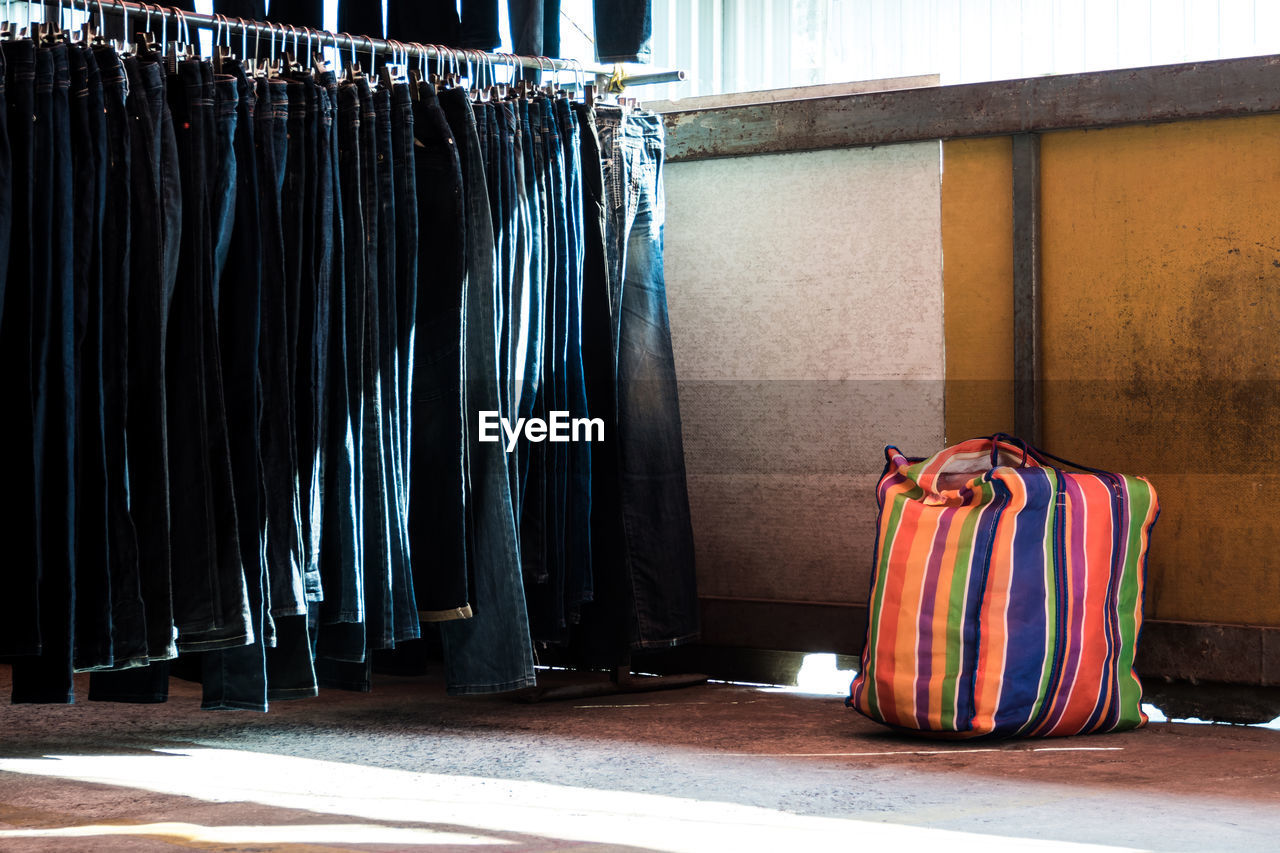 View of jeans handing on rack