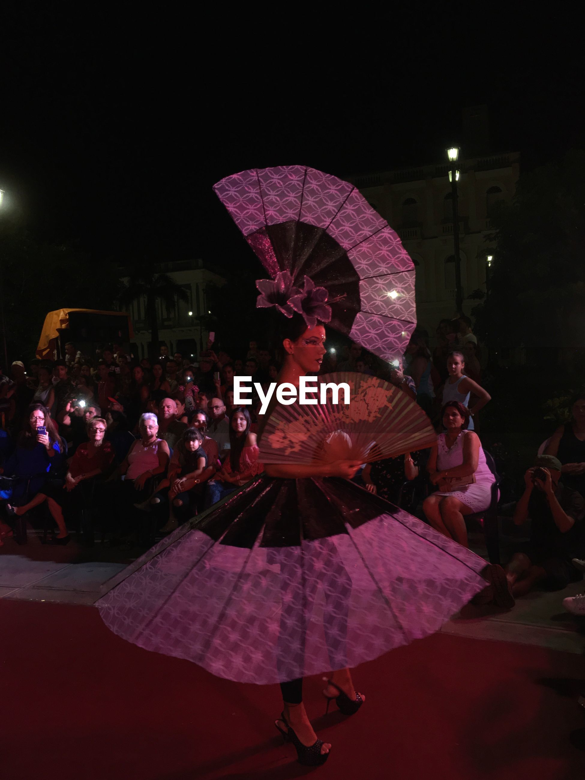 large group of people, real people, night, performance, leisure activity, dancing, illuminated, women, celebration, men, arts culture and entertainment, lifestyles, togetherness, full length, outdoors, city, people