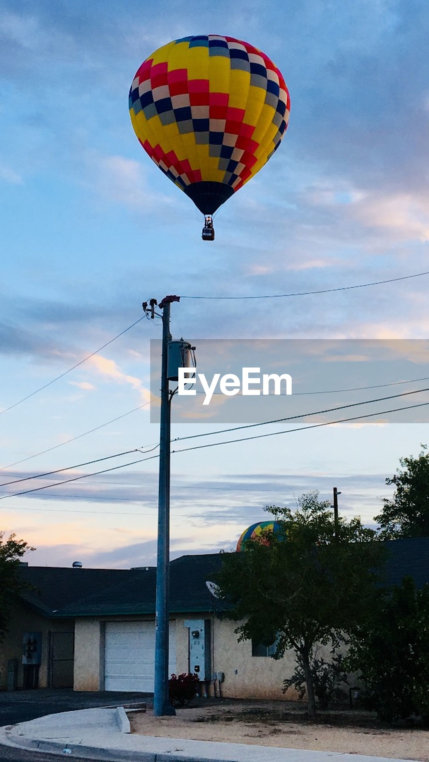 sky, transportation, nature, cloud - sky, low angle view, plant, tree, balloon, architecture, built structure, building exterior, no people, flying, outdoors, air vehicle, mid-air, hot air balloon, adventure, day, mode of transportation