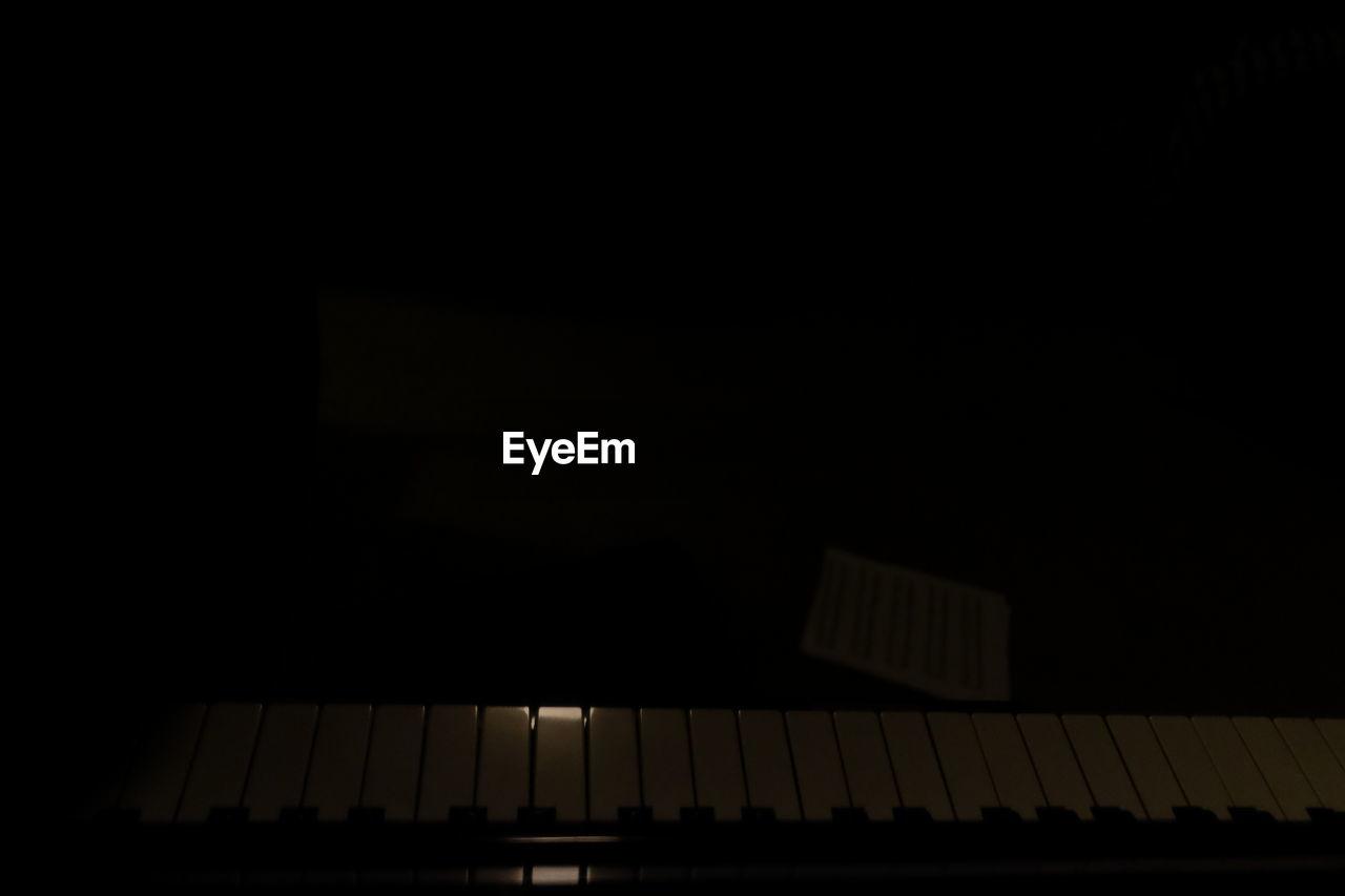 music, musical instrument, dark, piano, no people, piano key, indoors, night