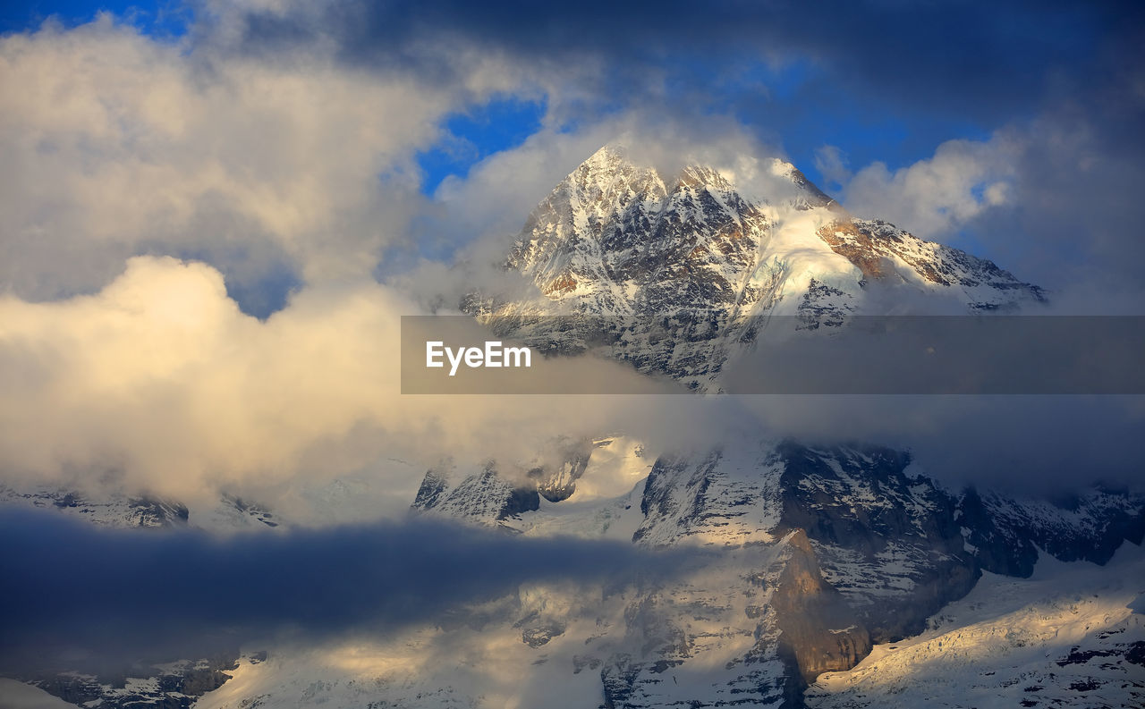cold temperature, snow, winter, nature, tranquility, mountain, scenics, beauty in nature, tranquil scene, weather, cloud - sky, no people, majestic, snowcapped mountain, outdoors, sky, idyllic, mountain range, day, landscape