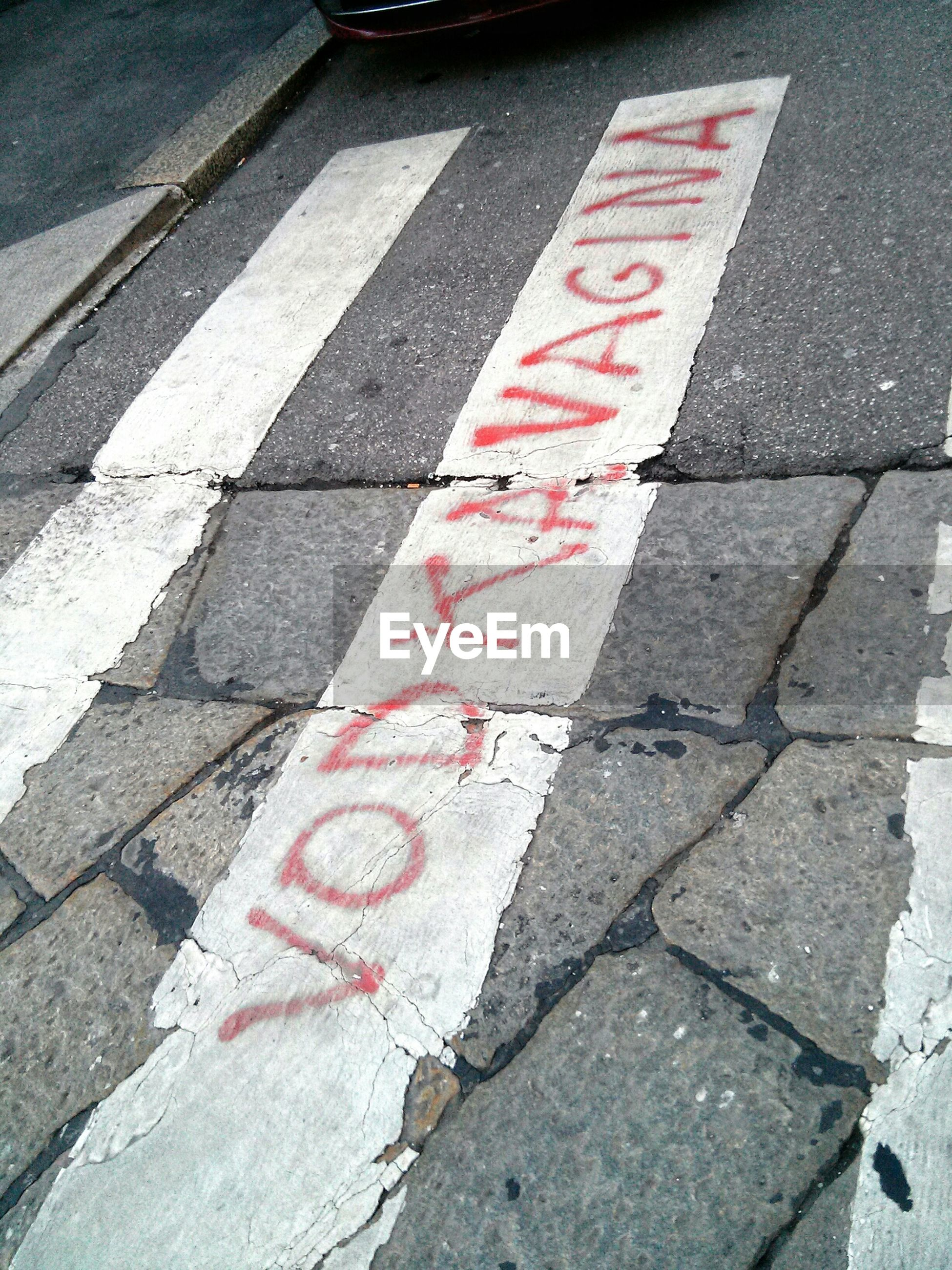 road marking, street, guidance, high angle view, asphalt, road, red, transportation, communication, road sign, text, direction, directional sign, arrow symbol, sign, western script, zebra crossing, sidewalk, day, outdoors