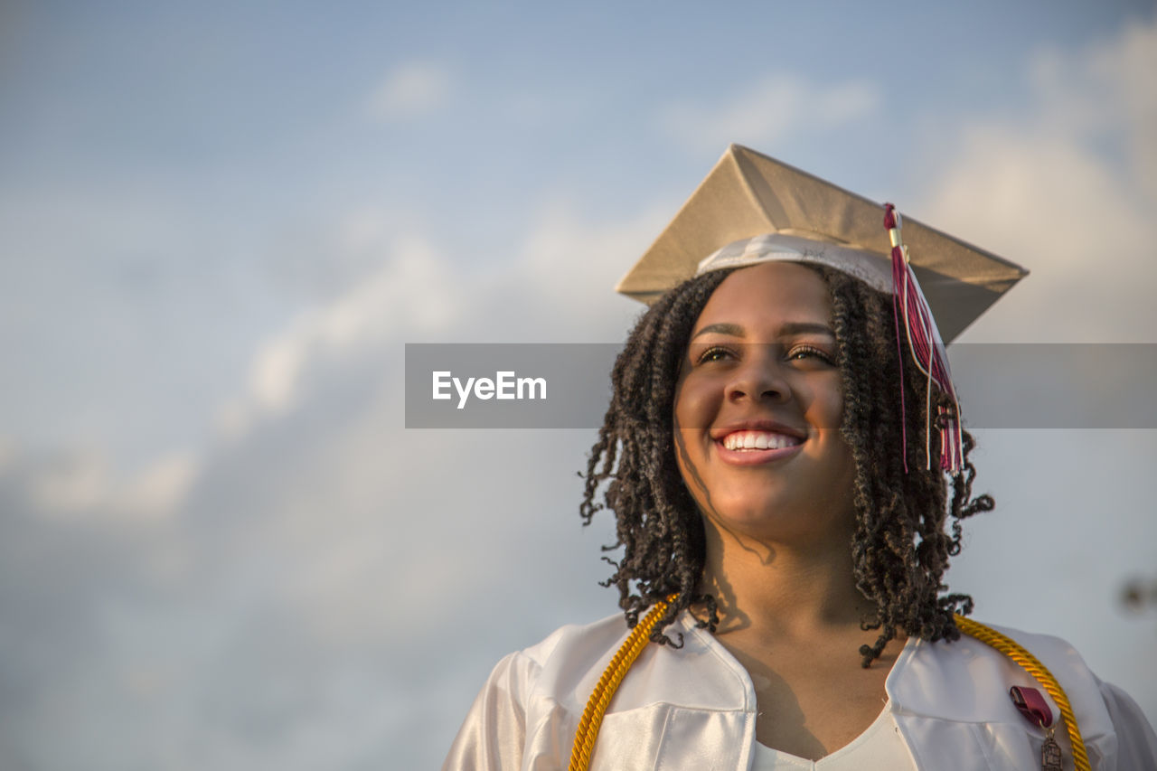 portrait, one person, women, smiling, happiness, headshot, females, real people, emotion, student, leisure activity, child, day, looking at camera, front view, education, girls, graduation, standing, outdoors, hairstyle, teenager