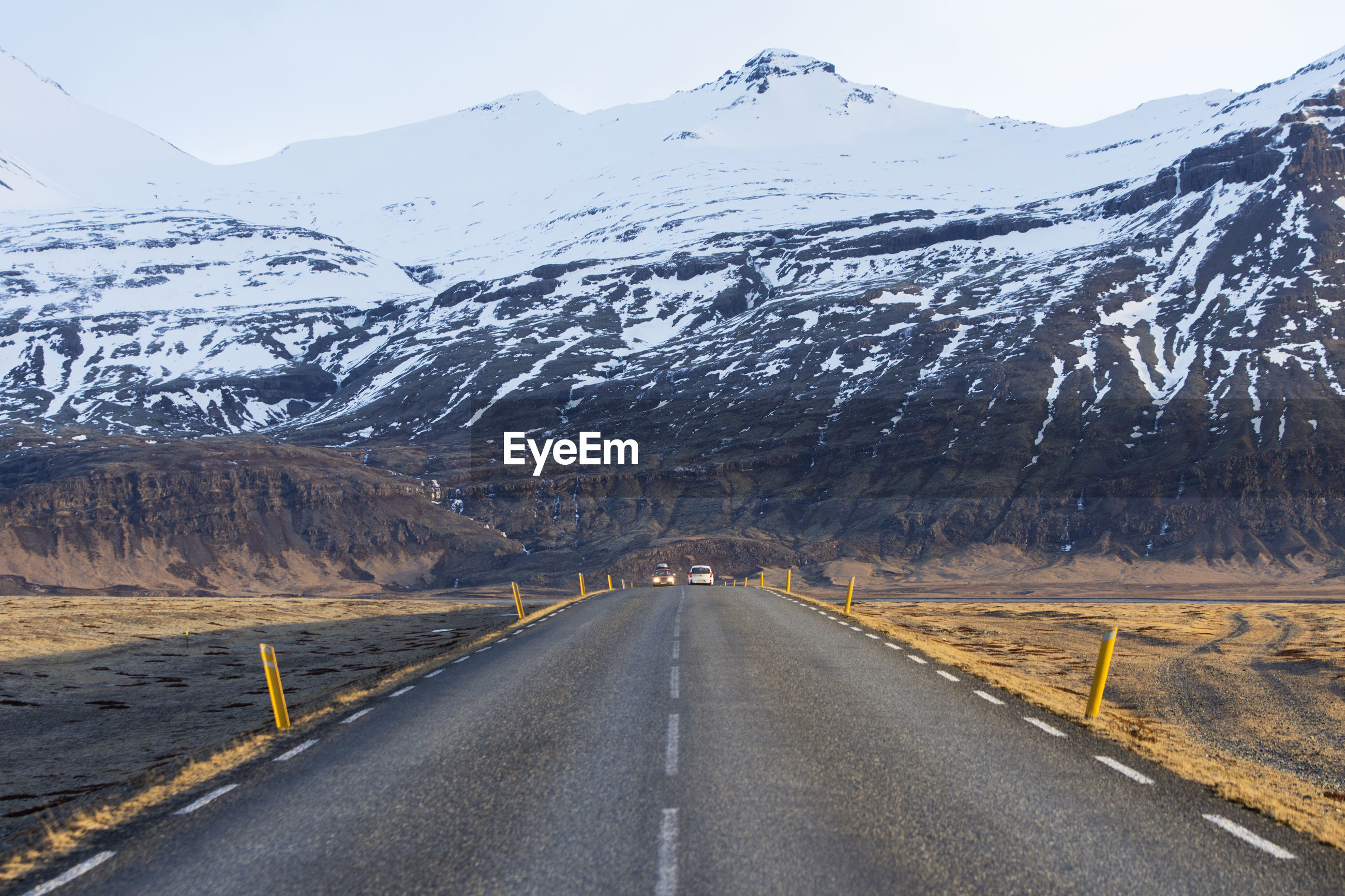 ROAD ON SNOWCAPPED MOUNTAINS AGAINST SKY