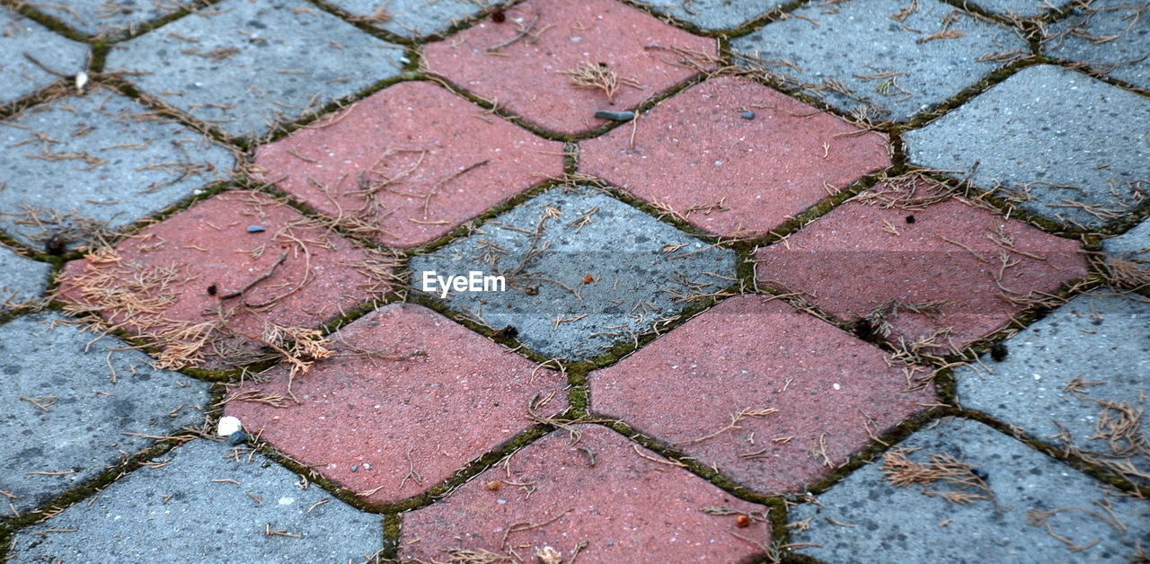 full frame, backgrounds, footpath, pattern, paving stone, cobblestone, high angle view, stone, no people, day, textured, shape, street, close-up, geometric shape, outdoors, design, sidewalk, directly above, rough