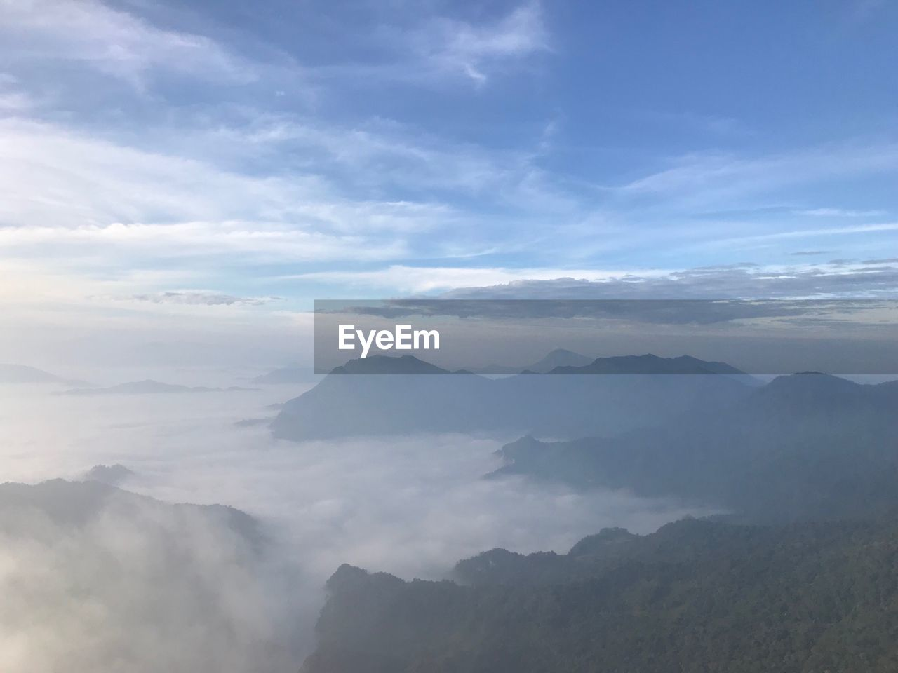 cloud - sky, beauty in nature, scenics - nature, mountain, sky, tranquil scene, tranquility, fog, non-urban scene, mountain range, idyllic, no people, nature, day, environment, landscape, outdoors, remote, physical geography, hazy, mountain peak