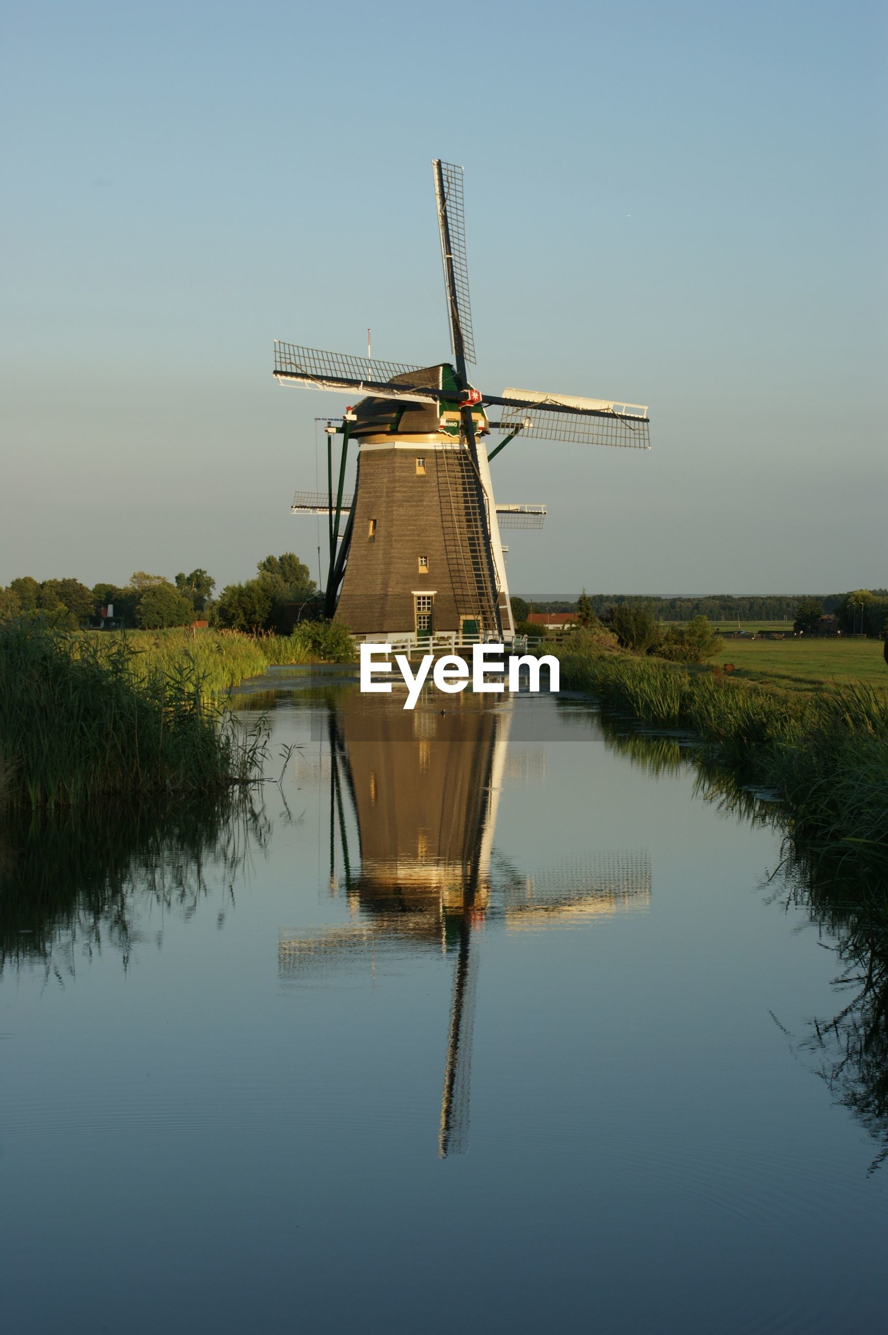 windmill, wind power, alternative energy, renewable energy, wind turbine, water, environmental conservation, fuel and power generation, traditional windmill, clear sky, lake, rural scene, tranquil scene, field, grass, tranquility, nature, landscape, reflection, technology