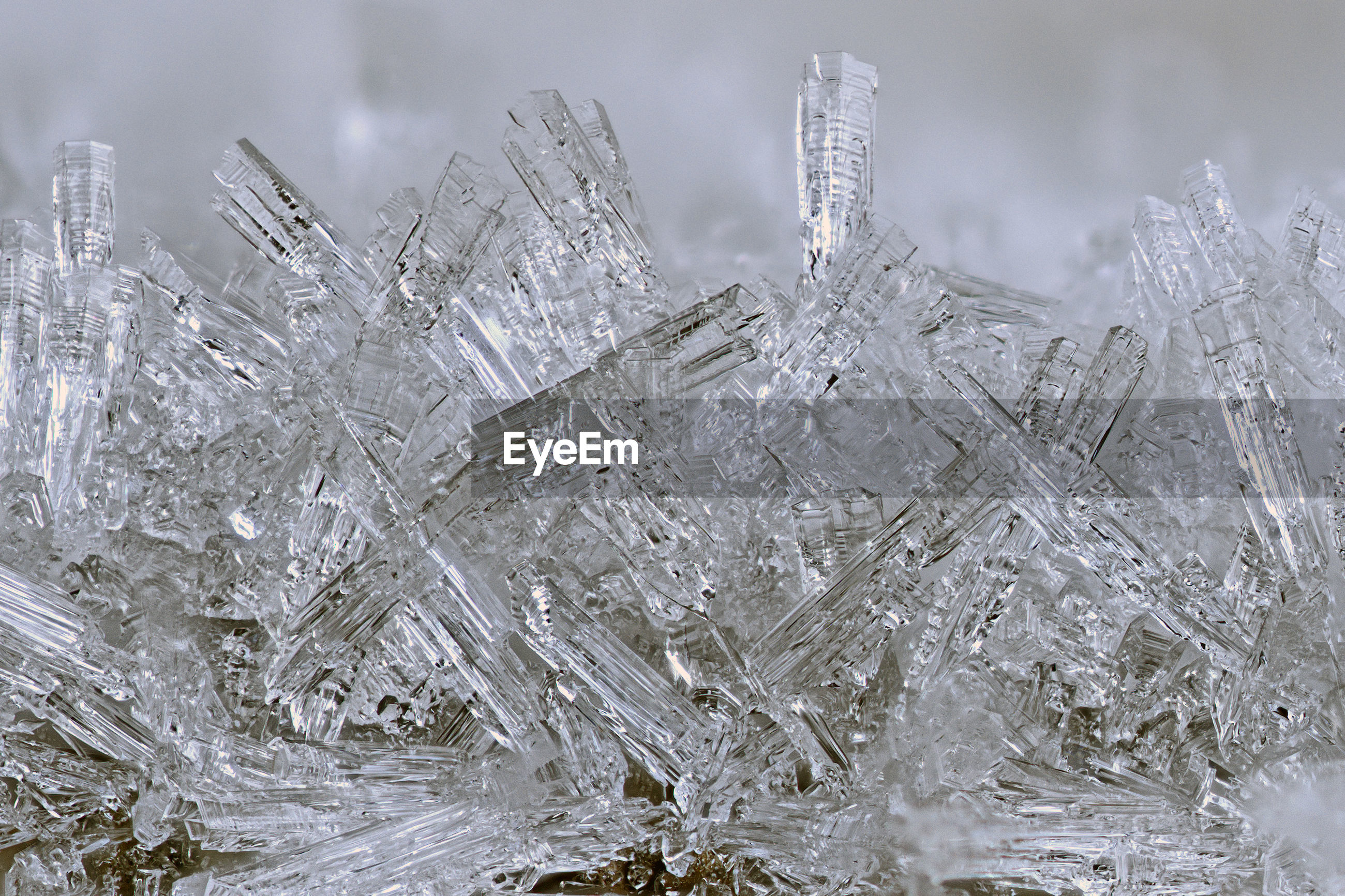 CLOSE-UP OF ICE CRYSTALS AGAINST CLOUDS