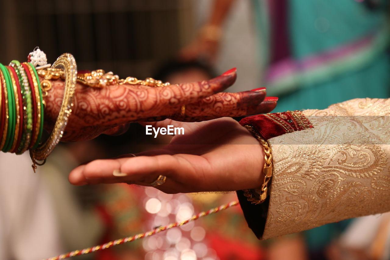 focus on foreground, celebration, henna tattoo, human hand, human body part, hand, real people, tattoo, women, event, newlywed, close-up, bride, wedding, bracelet, adult, bangle, wedding ceremony, finger